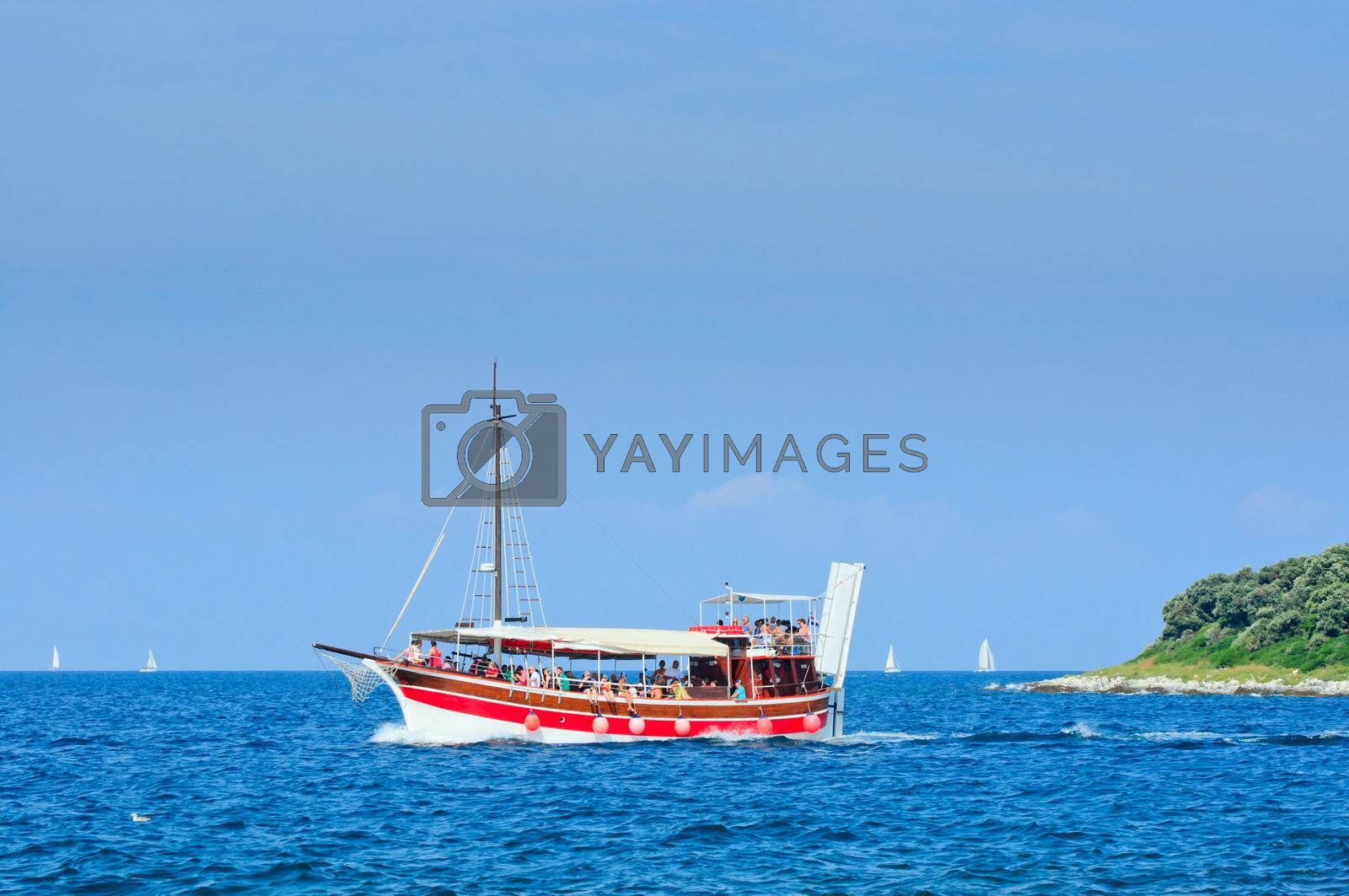 Red Tourists floating on a boat on the sea of Adriatic