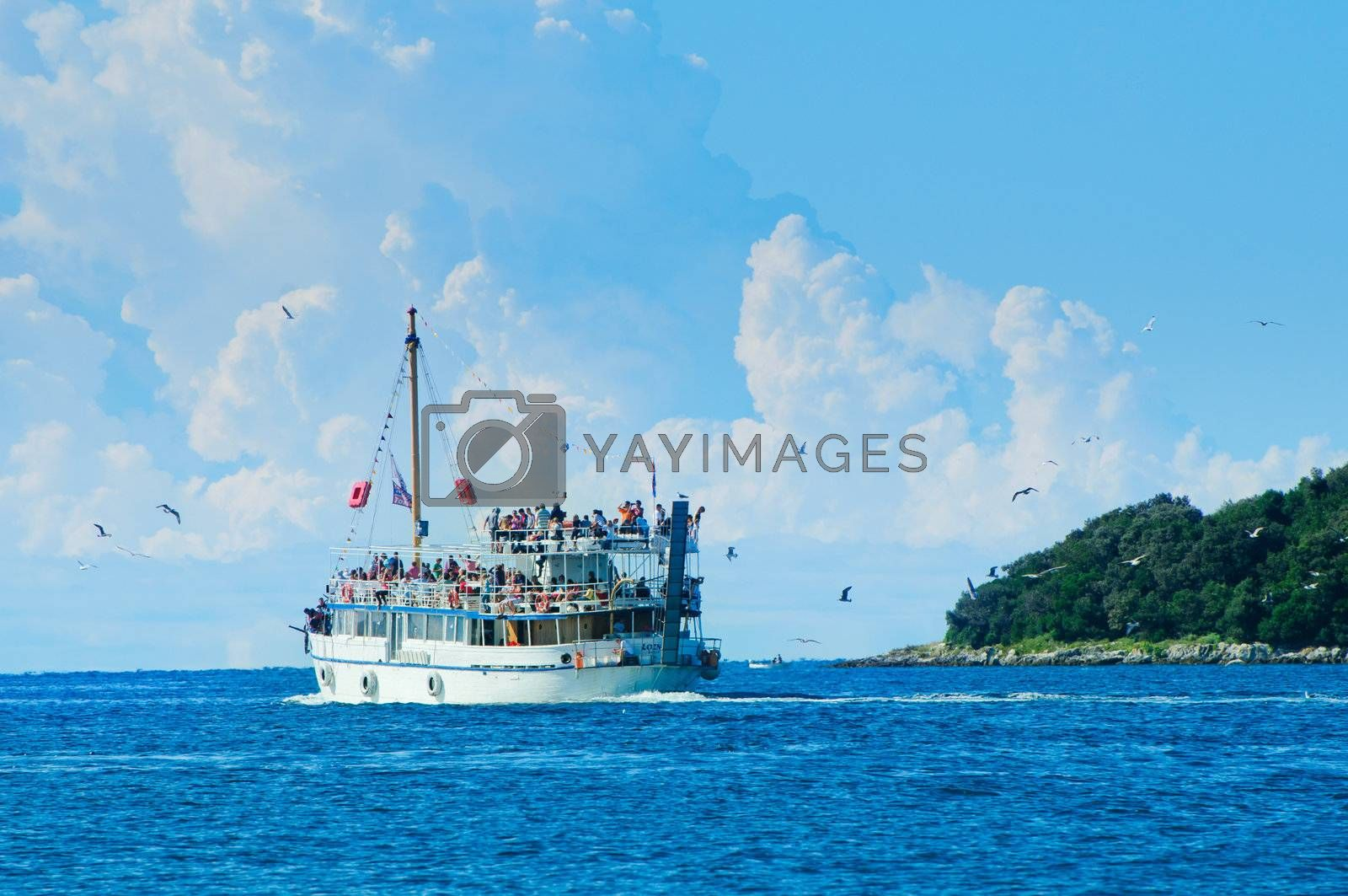 Tourists floating on white boat on the sea of Adriatic