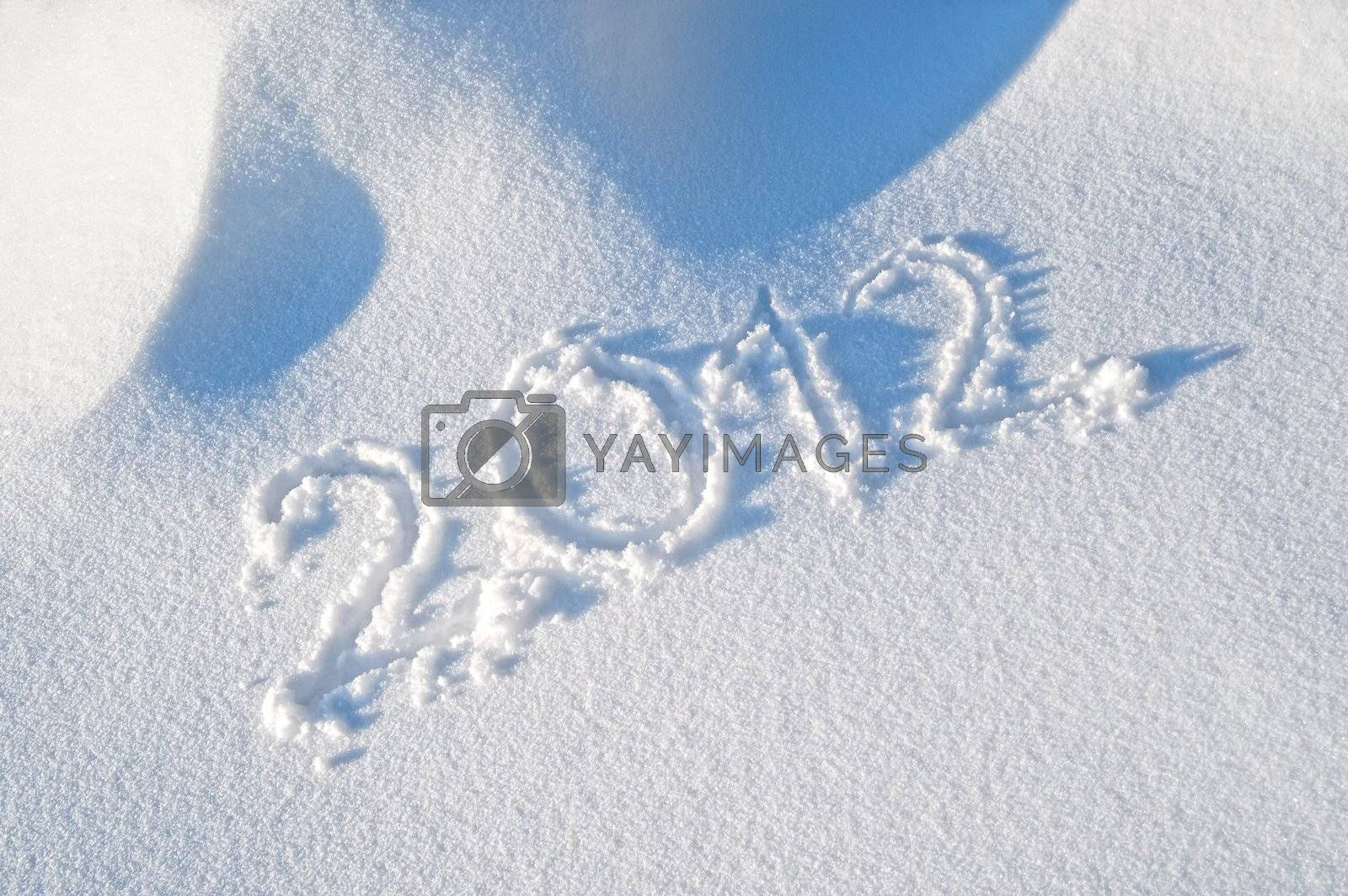 Royalty free image of Year 2012 written in the Snow by tepic