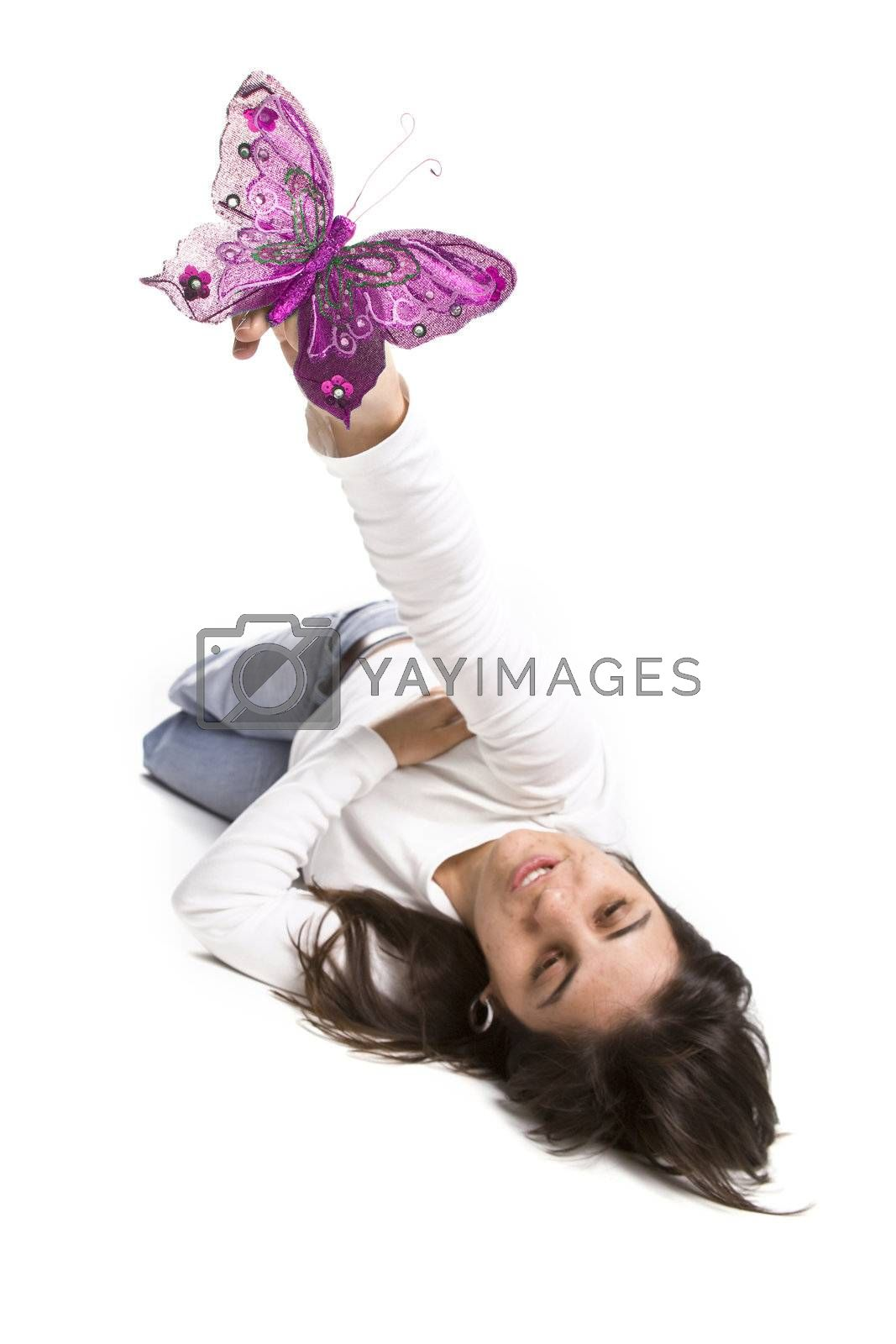 young casual woman playing with pink butterfly