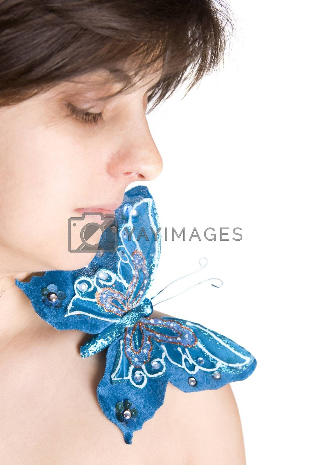 Beautiful young woman with butterfly in her naked shoulder