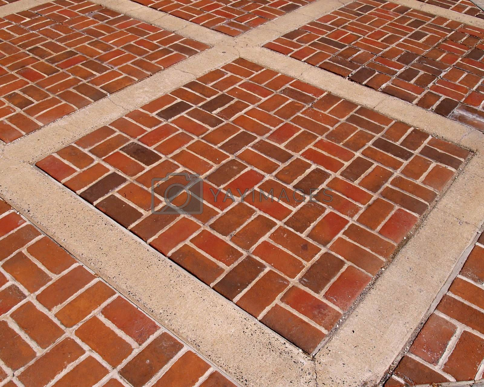 an abstract view of a brick patterned sidewalk