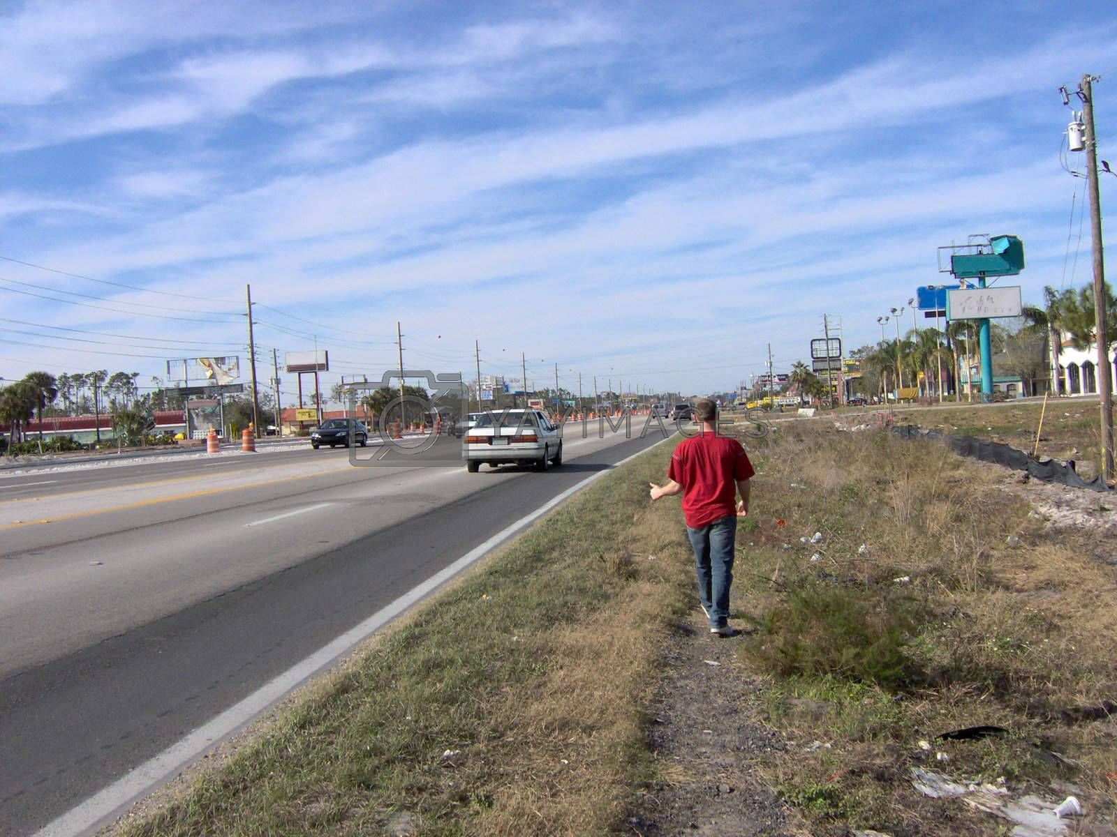 Hitchhiking on the side of a busy street in Florida, USA.