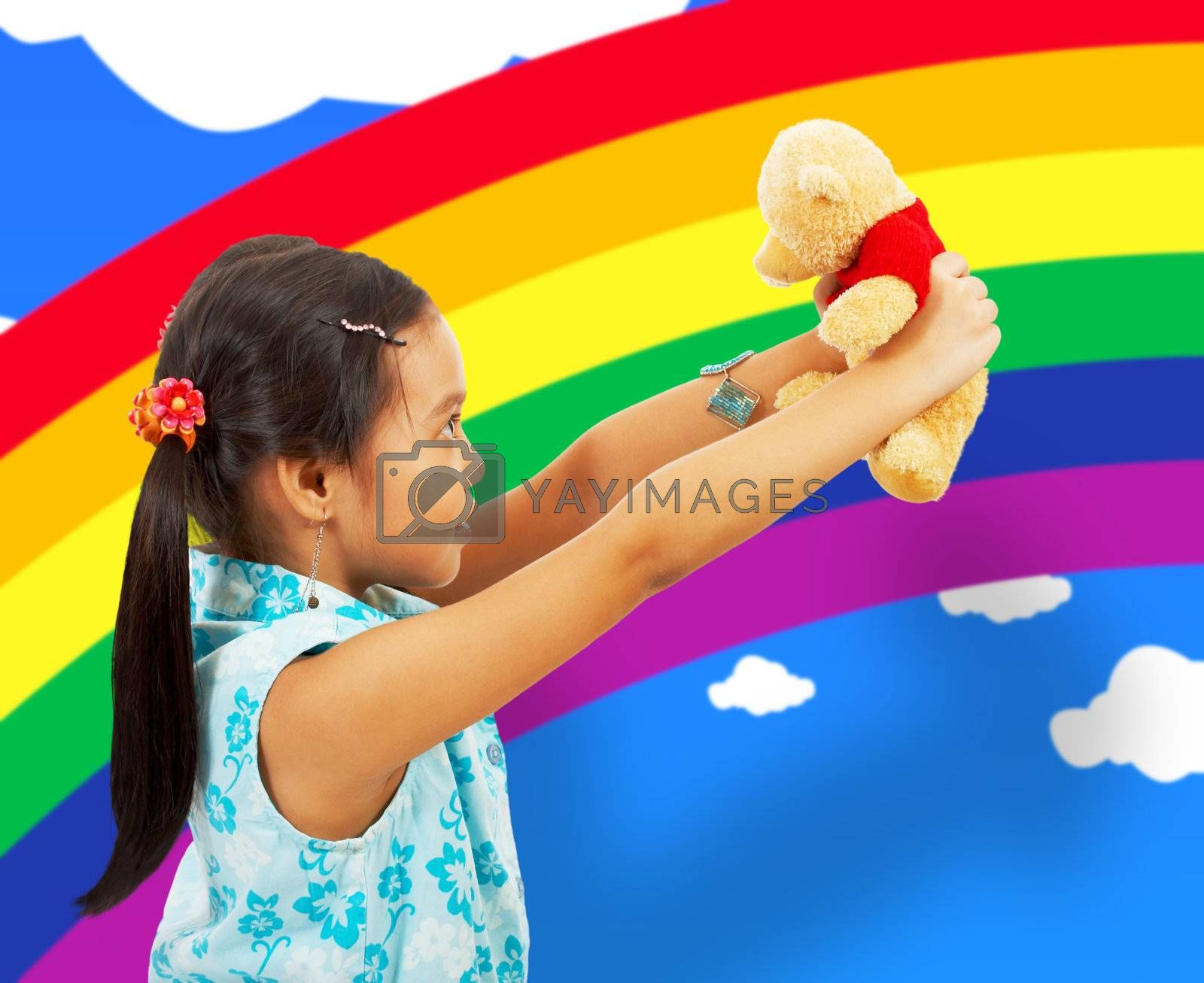 Young Girl Playing With Her Teddybear In Her Playroom With Rainbow Wallpaper