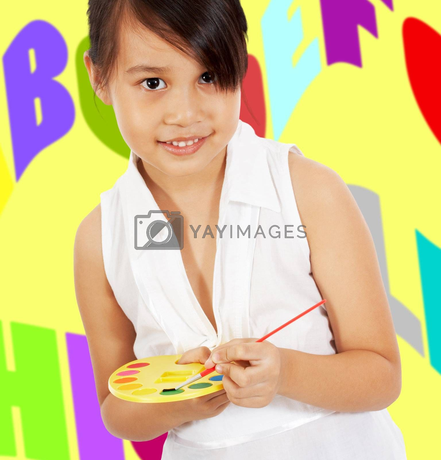 Young Girl Having Fun Painting Letters On The Wall