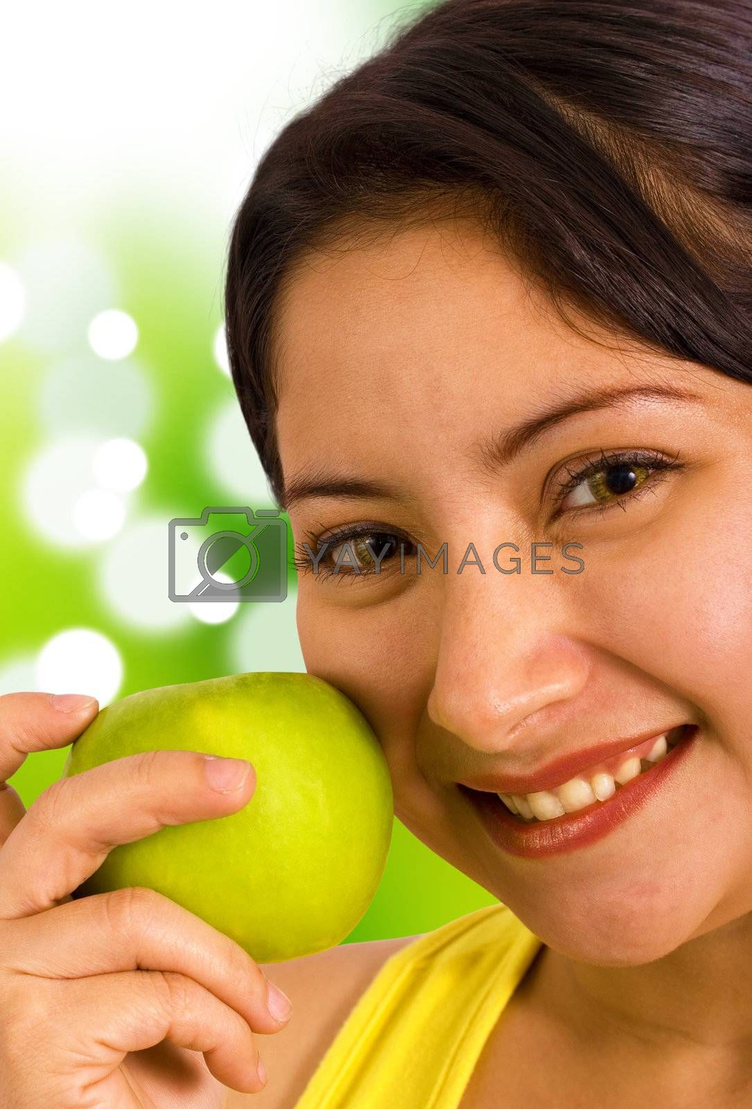 Young Lady Outside In The Sunshine Holding An Apple