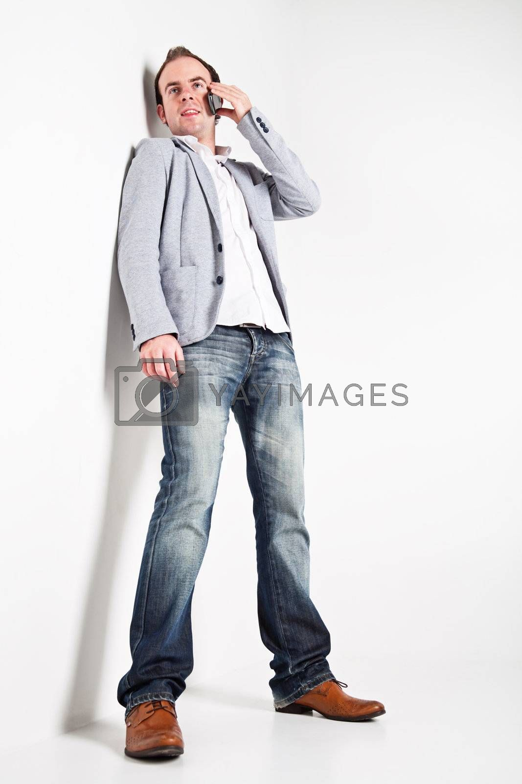 Low angle view at young man speaking on mobile phone