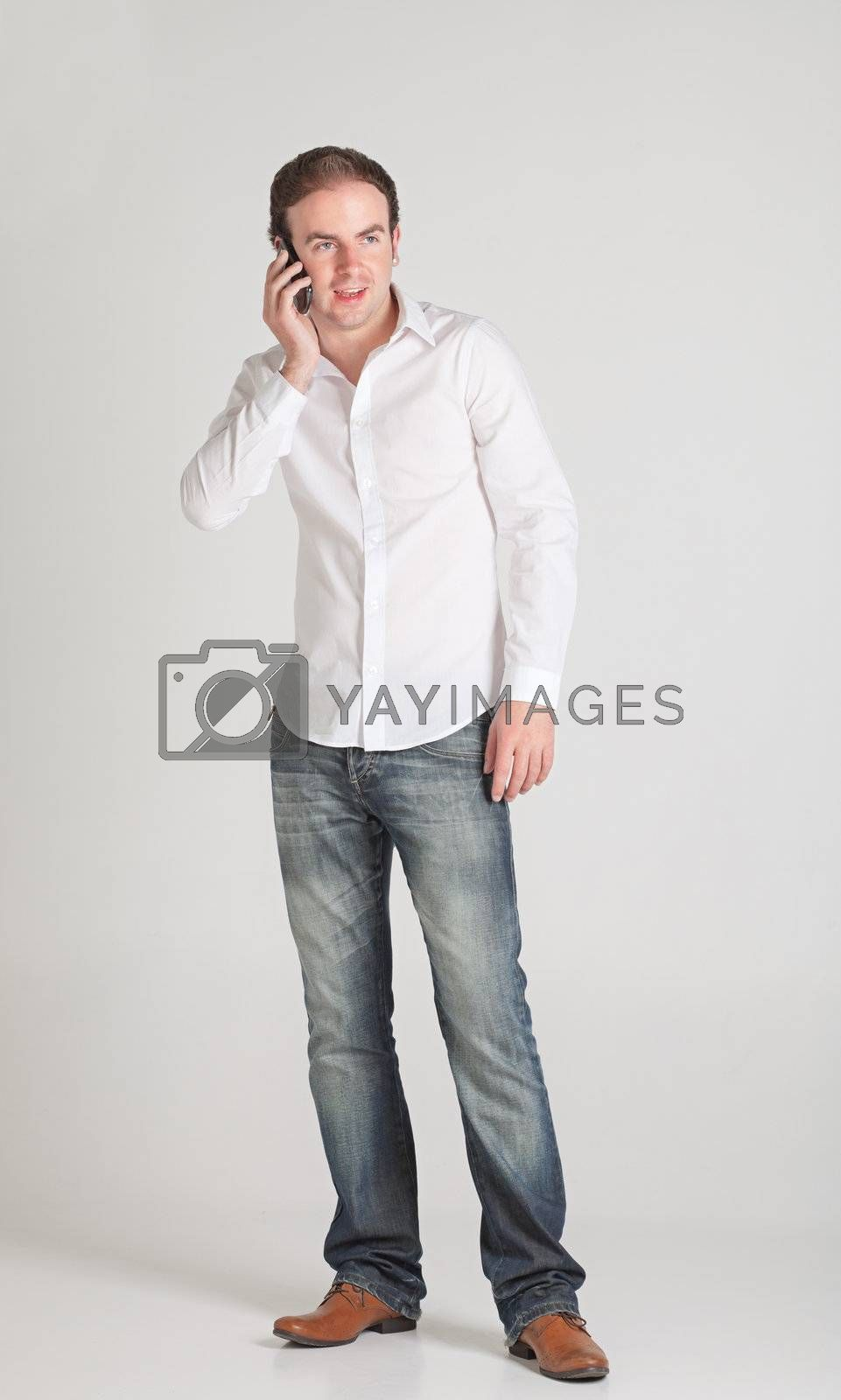 Portrait of young man talking on his cellphone