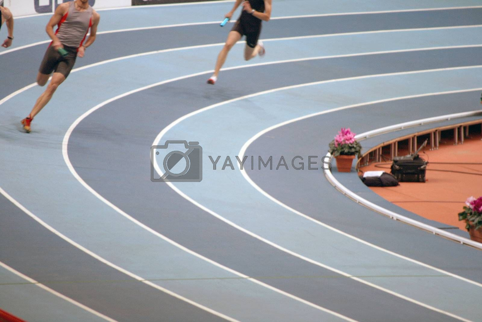 men indoors relay race sports and athletics concepts