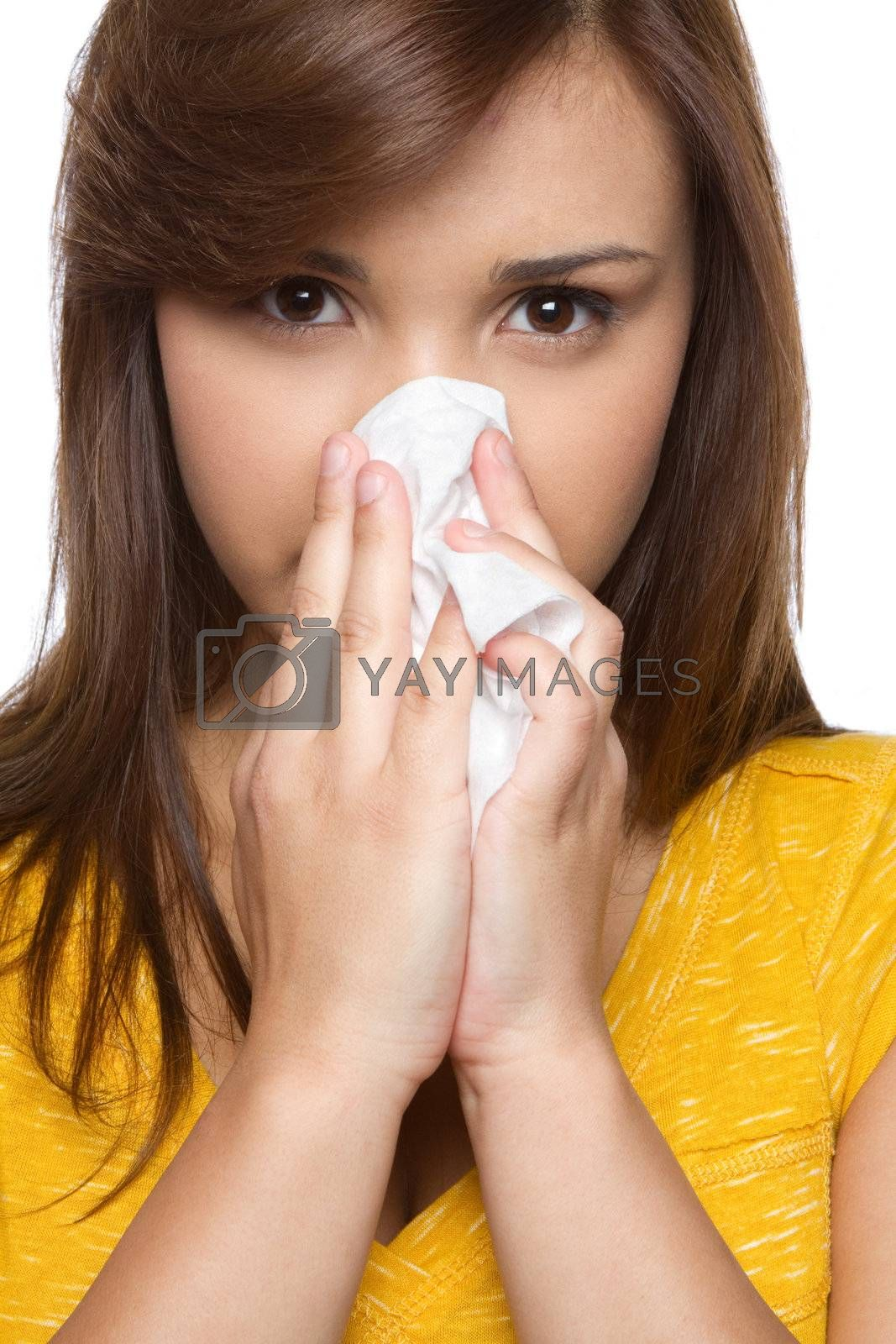 Pretty hispanic girl blowing nose