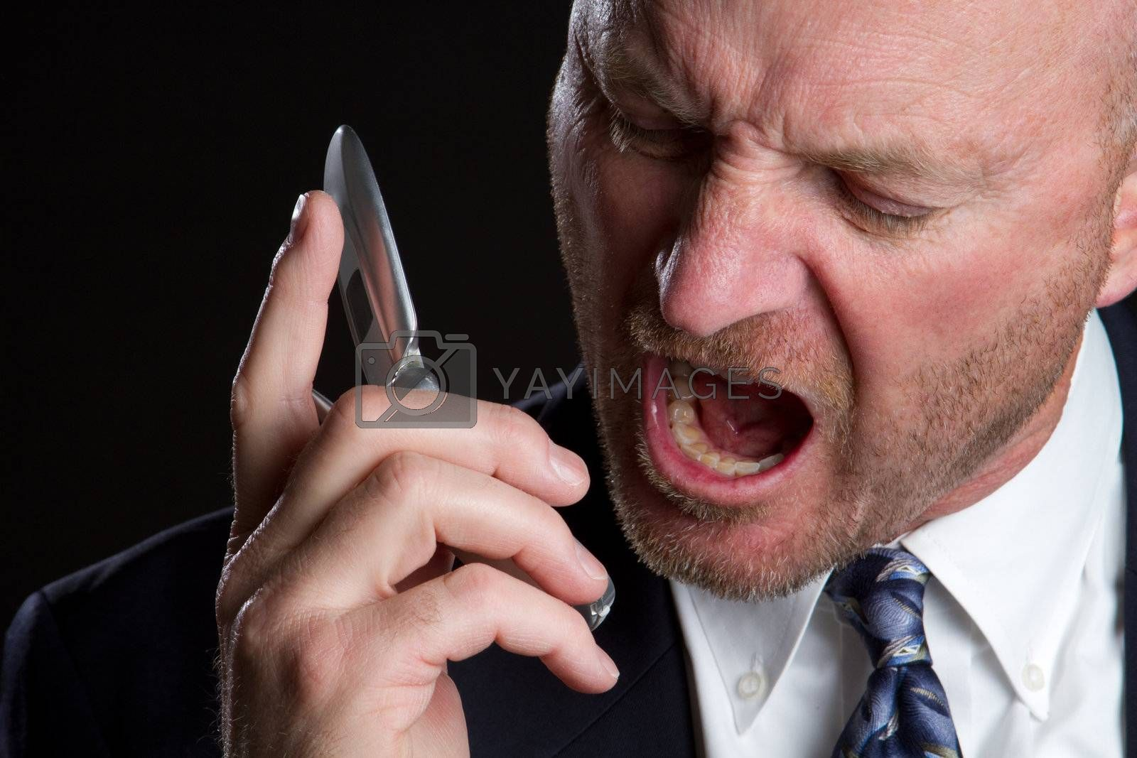 Angry man screaming on phone
