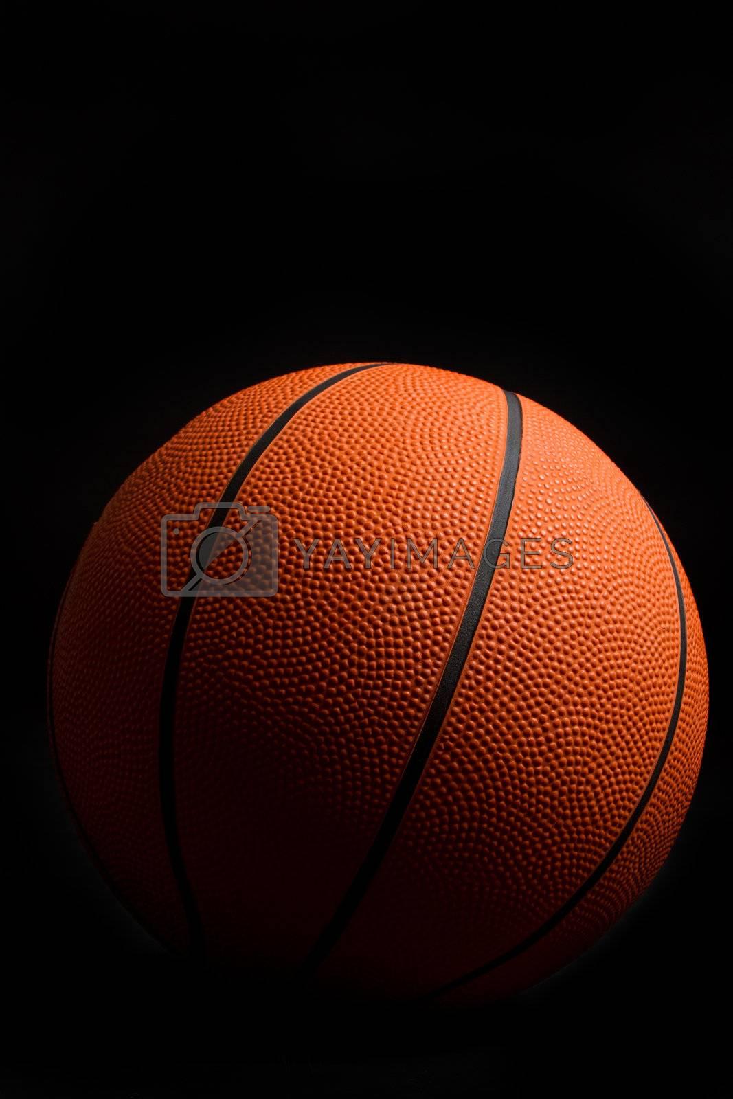 Orange basketball on black background