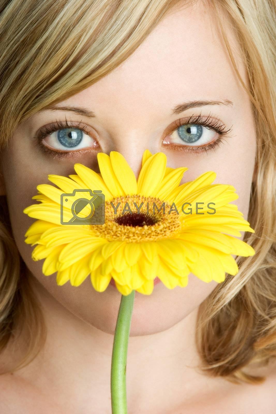 Beautiful girl and yellow flower