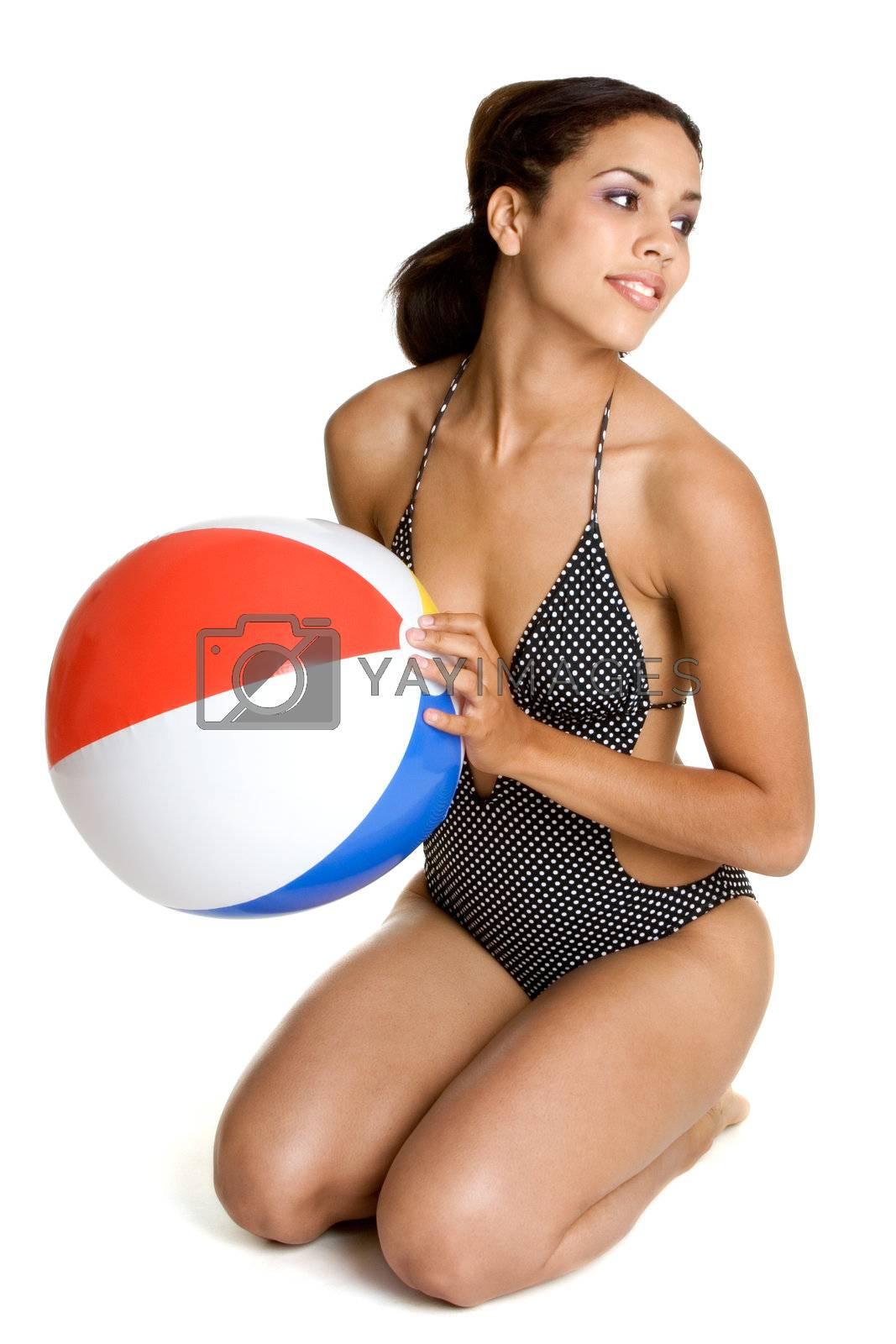 Isolated girl holding beach ball