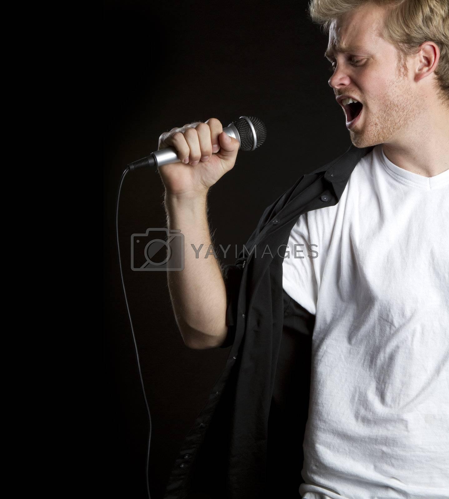 Young man singing microphone karaoke