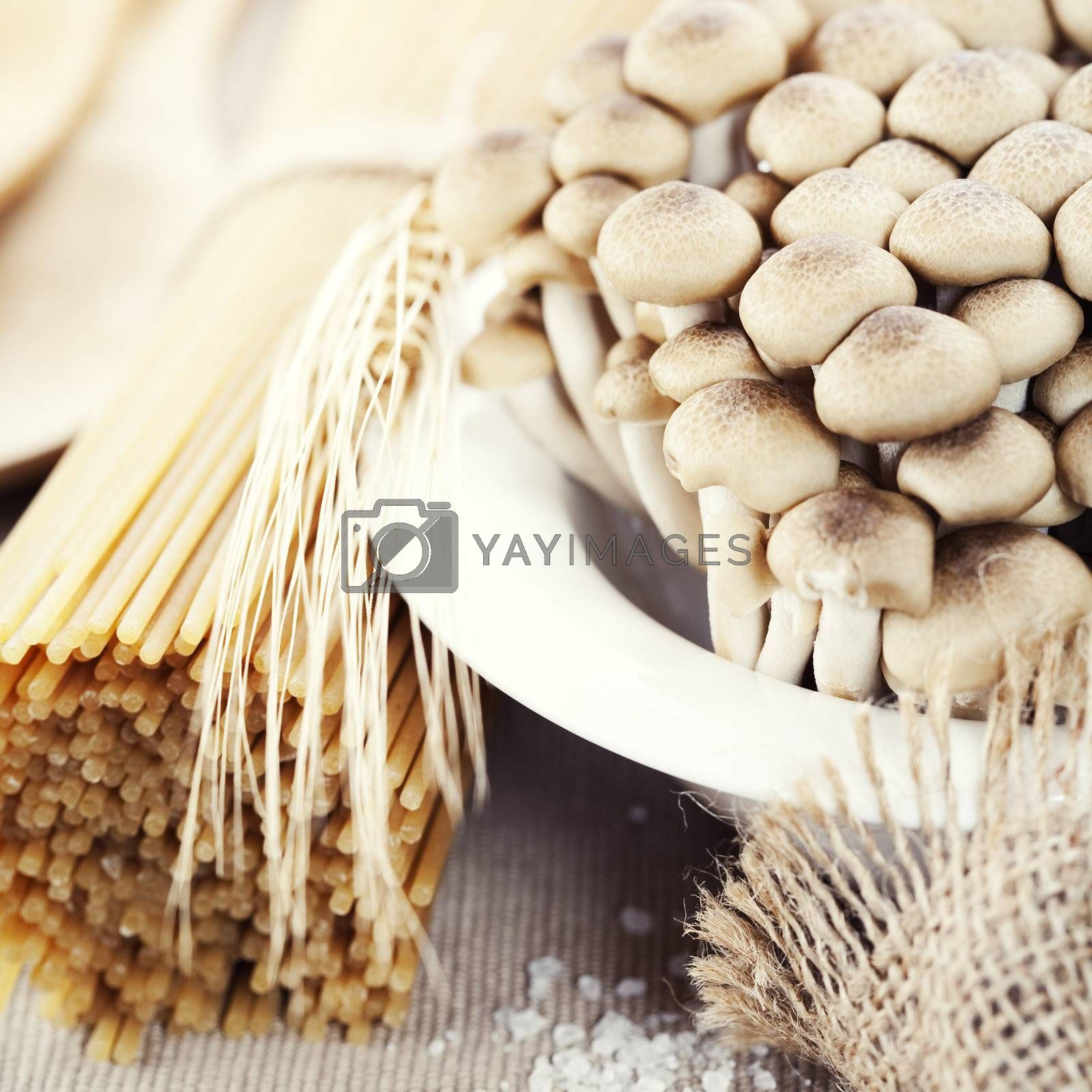 Raw Ingredients For Making Pasta (spaghetti, mushrooms)