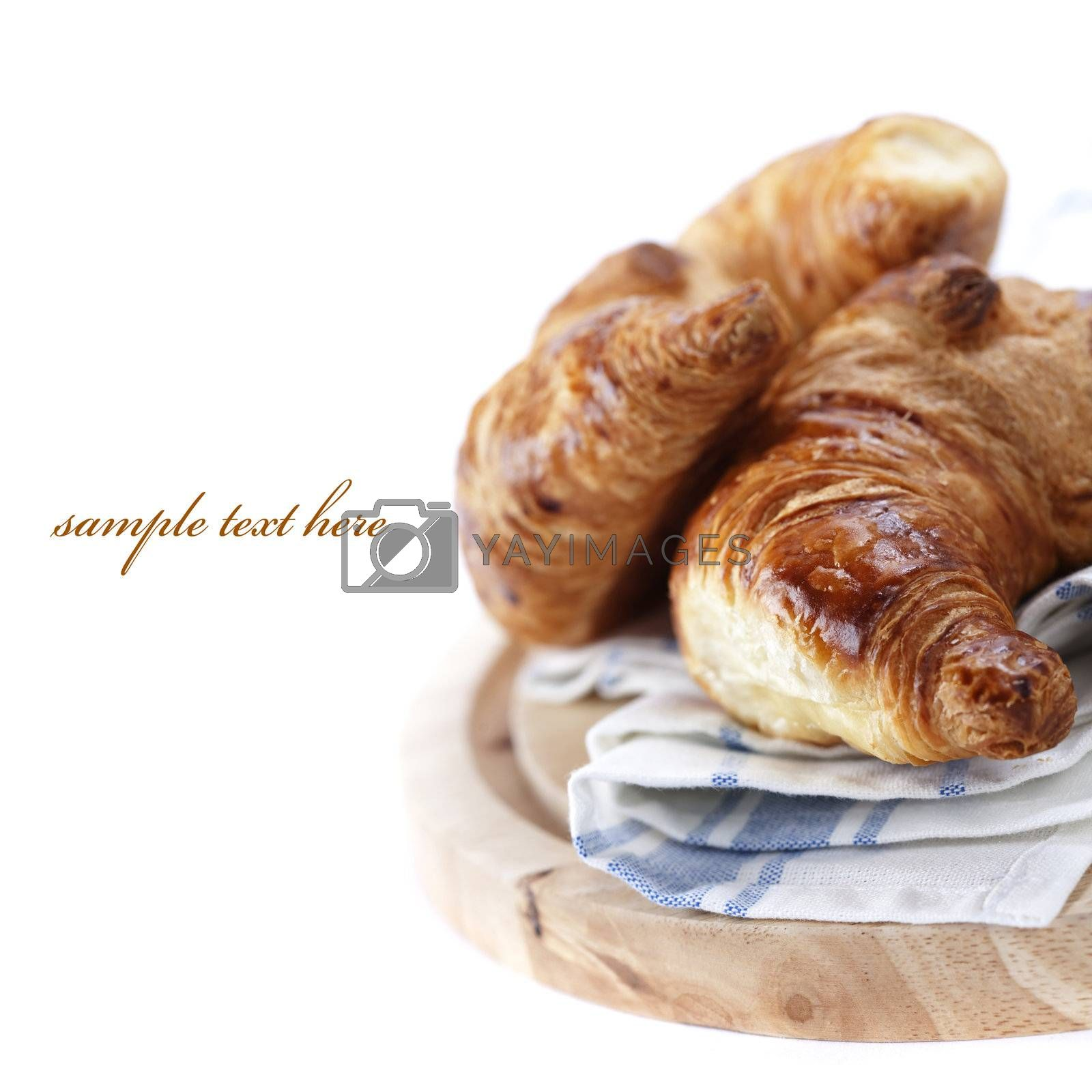 fresh croissants over white (easy removable text)