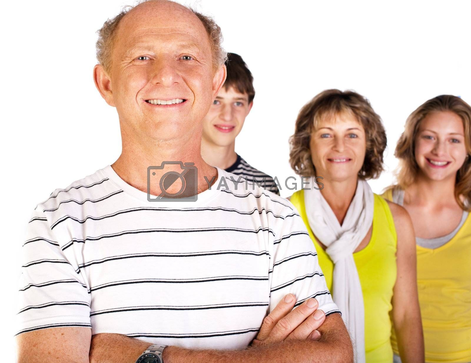 Happy family with old man in focus, arms folded isolated against the white background.