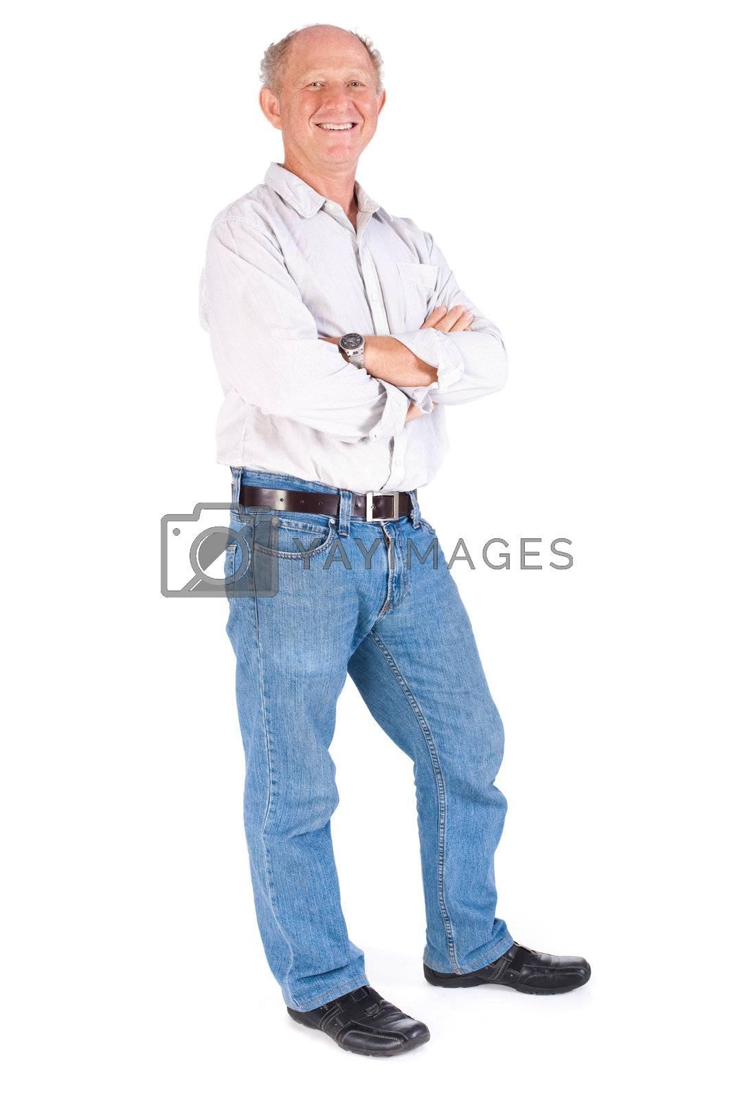Studio portrait of smiling senior man in casuals against white background.