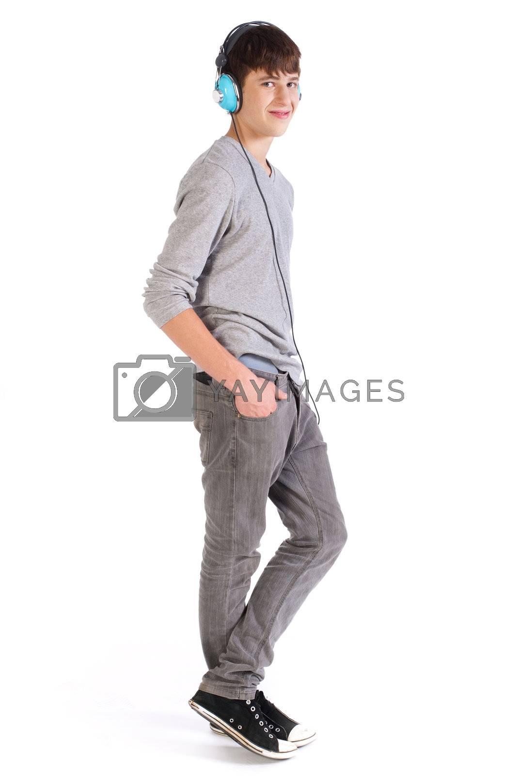 Teenager enjoying music and smiles, isolated on white background.