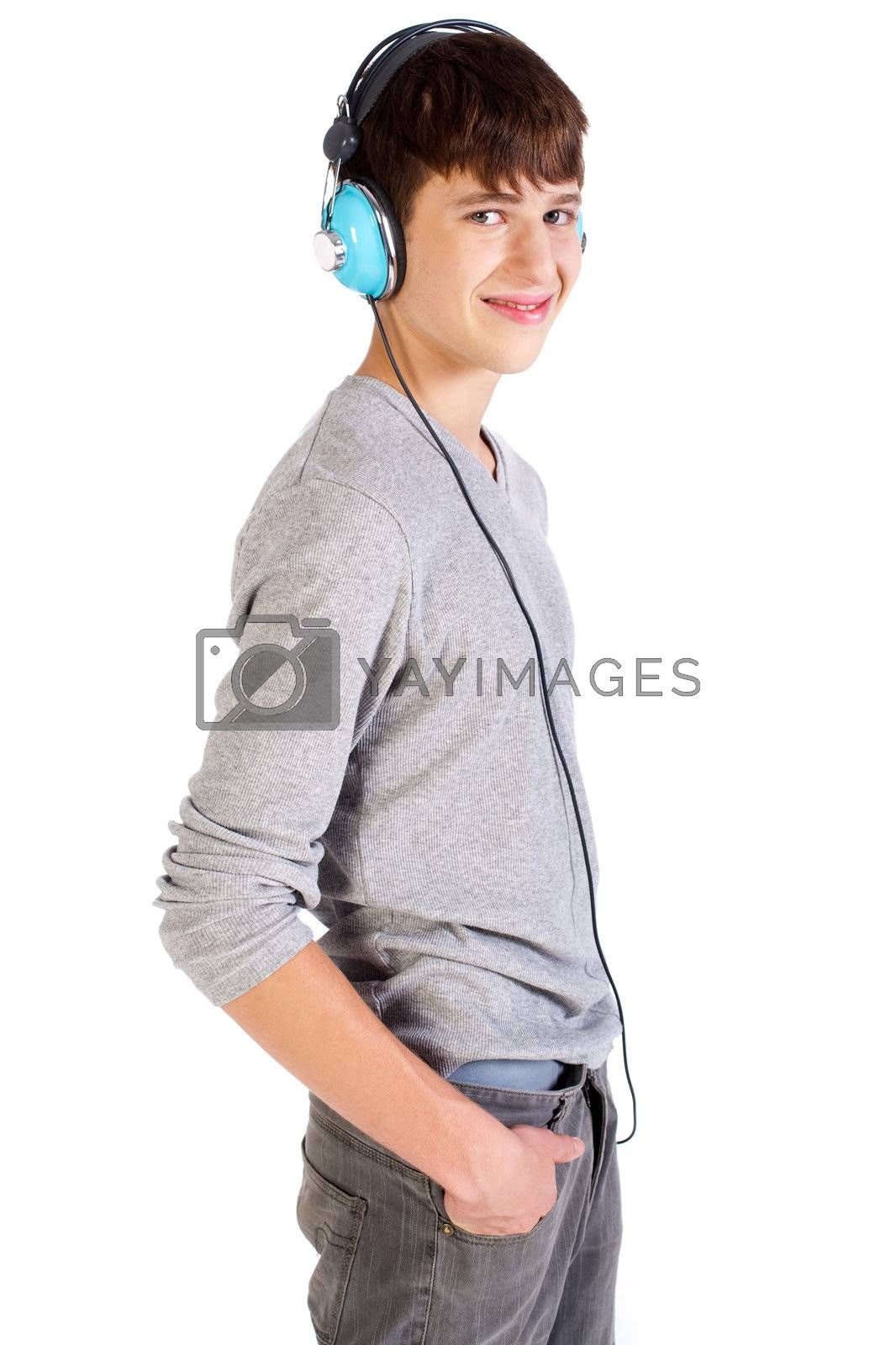 Teenager with headphones isolated over a white background.