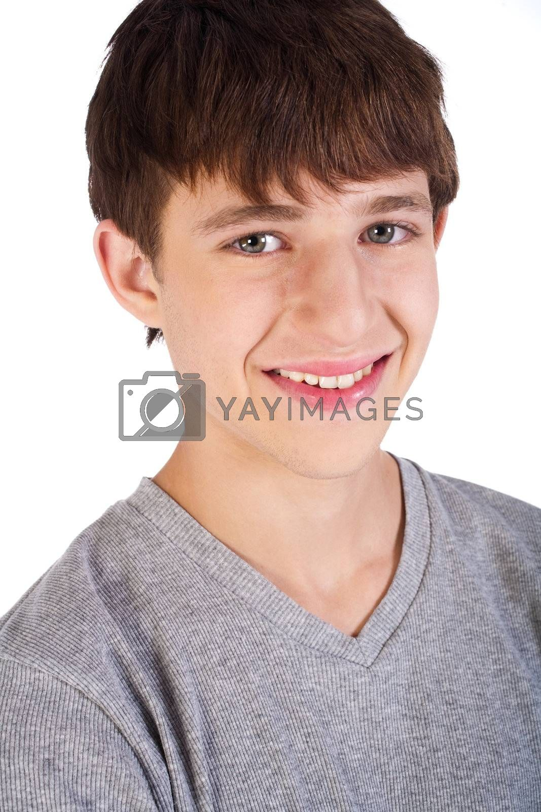 Close-up of hadnsome young boy smiling at camera.