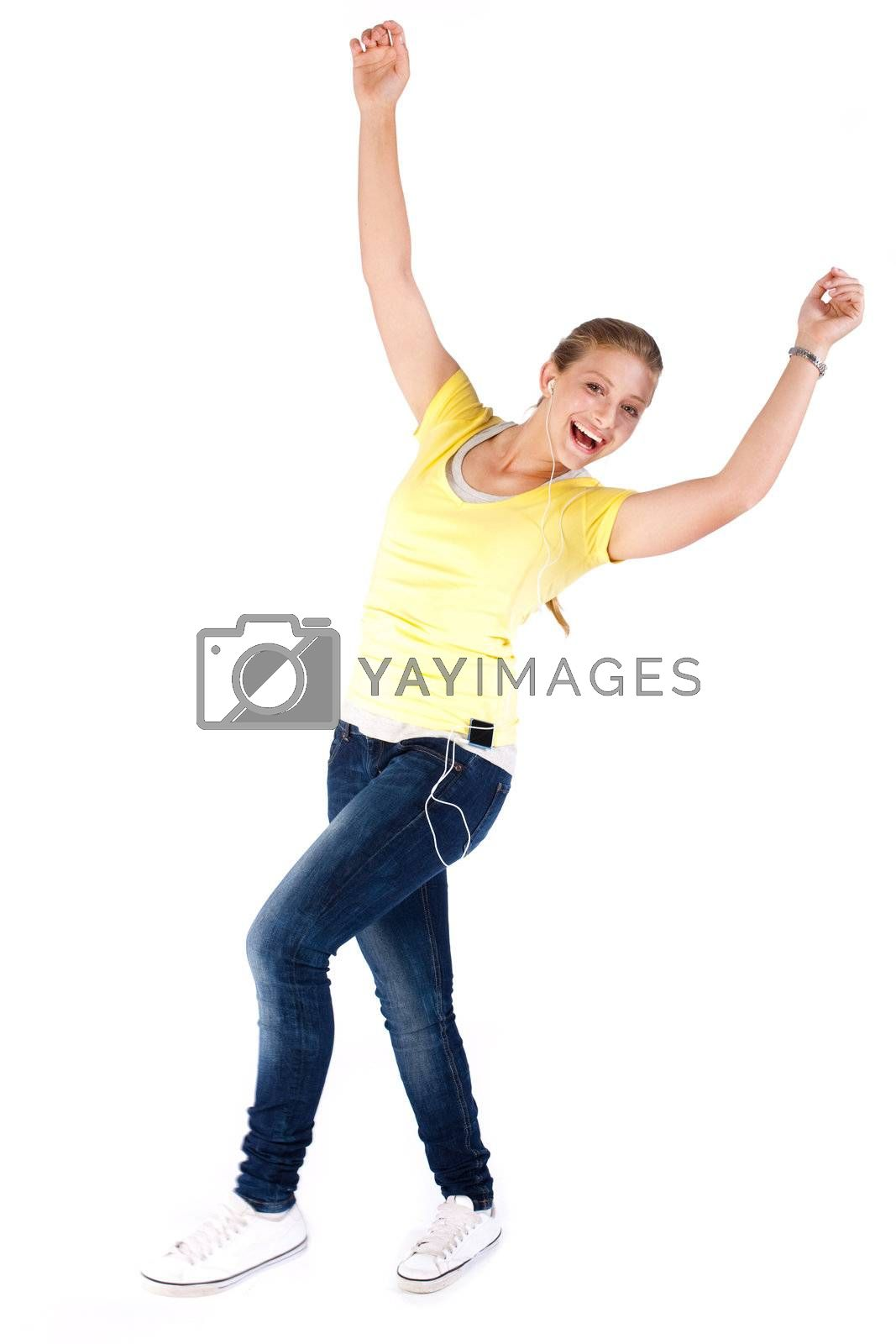 Cheerful young girl enjoying music and dancing isolated on white background.