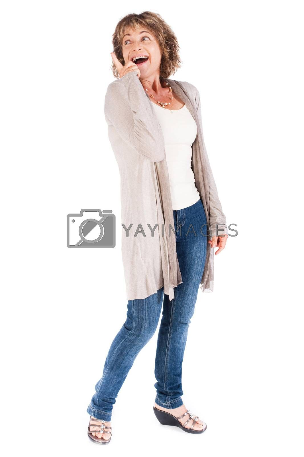 Senior woman pointing upwards and looking away over white background.