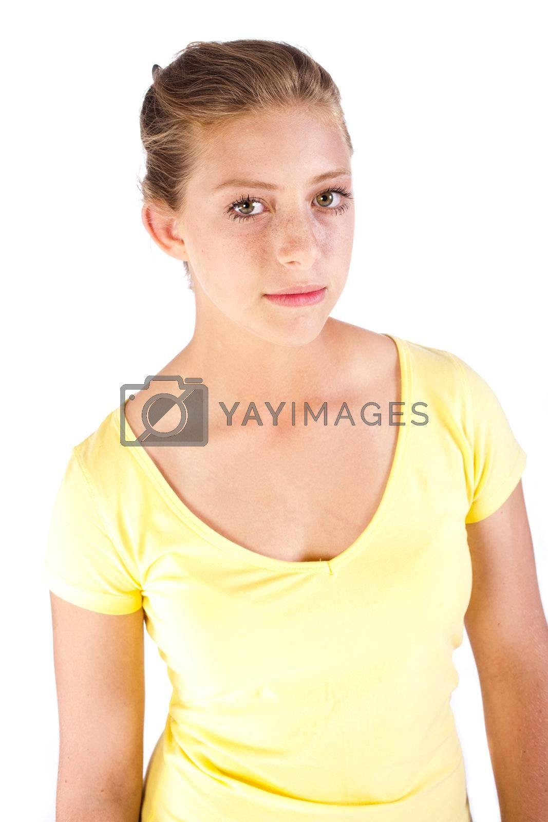 Close-up of beautiful young girl in yellow t-shirt..
