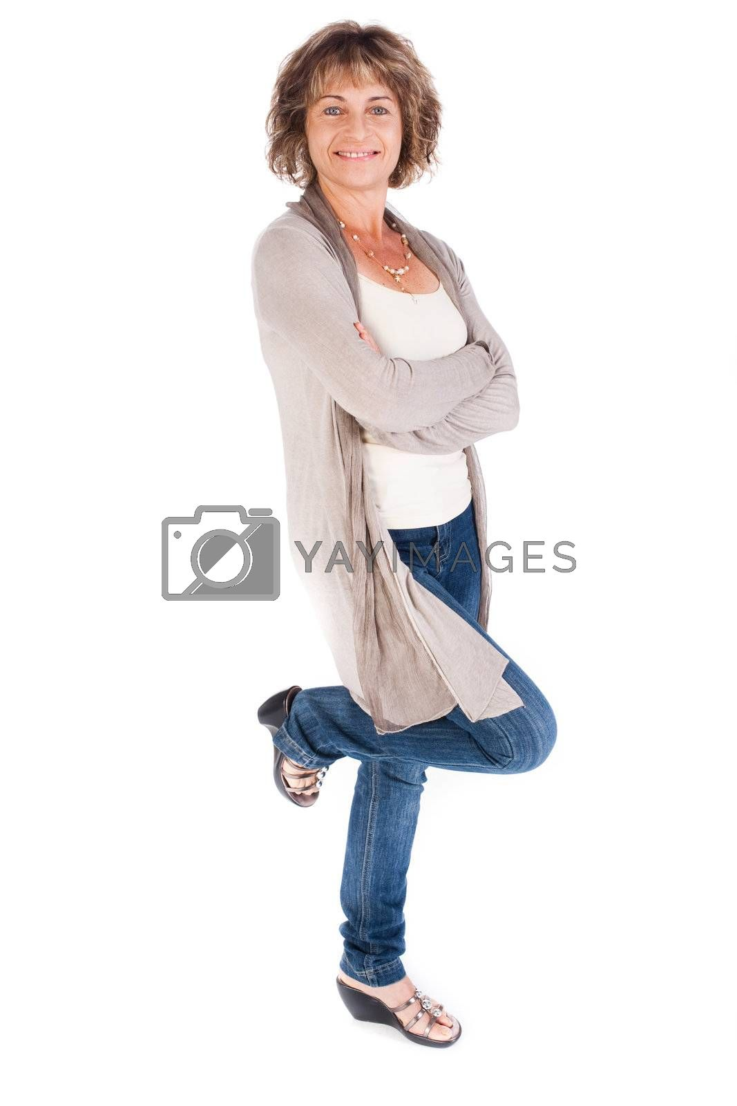 Attractive senior woman posing in style against white background..