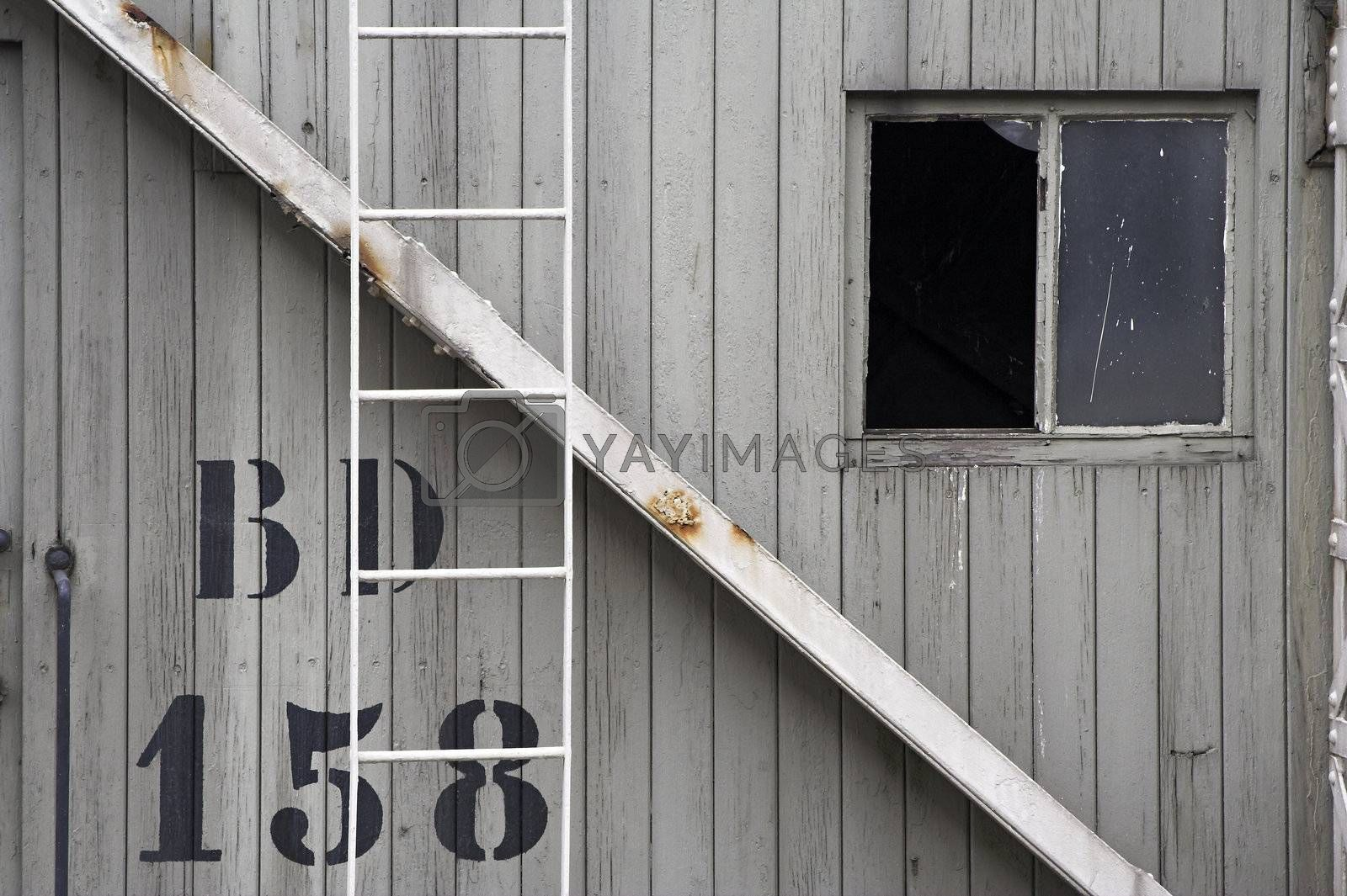 Close view of a side wall of an old port crane cabin