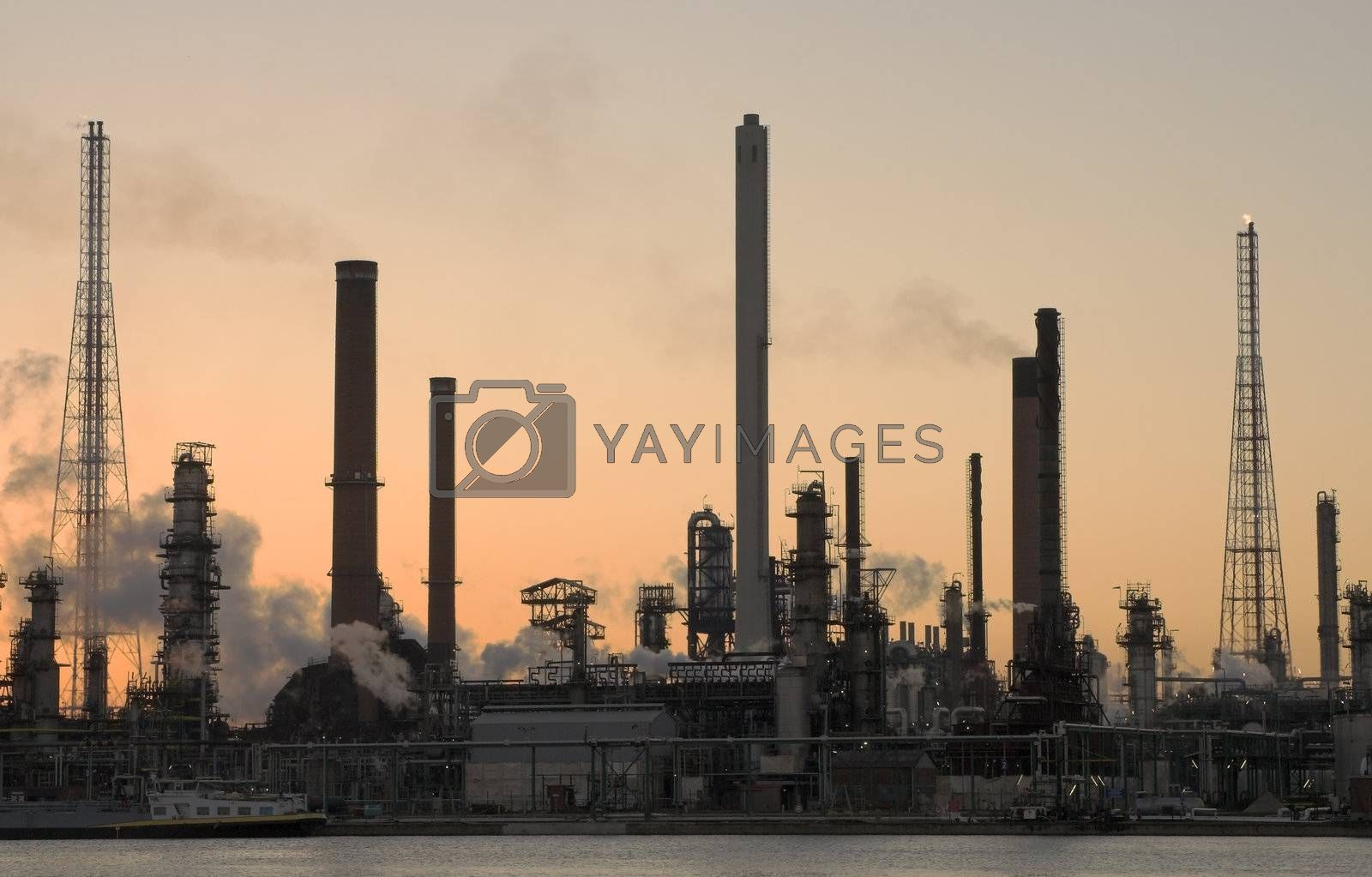 Oil refinery at sunset by MikLav