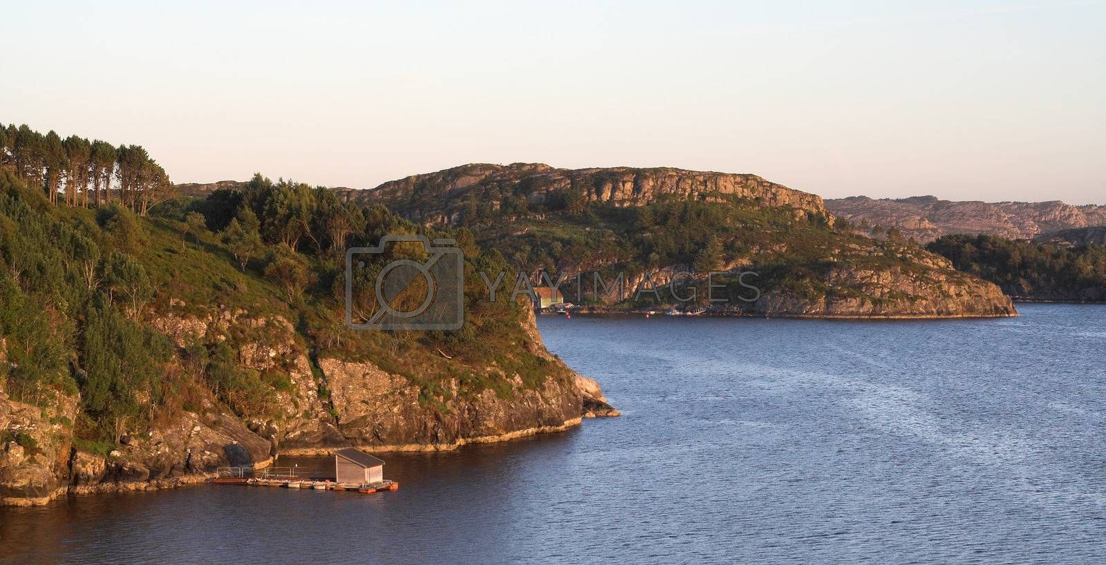 Rocky sea coast in sunset by MikLav
