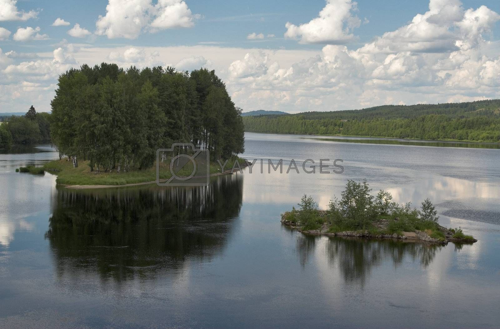 Two small islands on a river - Stoa, Norway