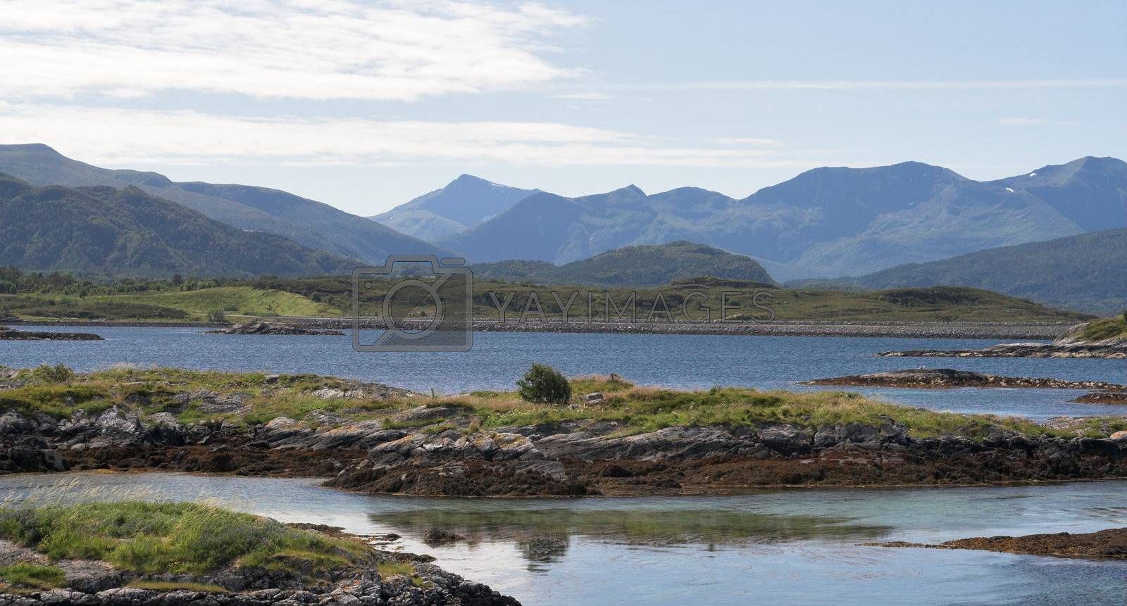 Panoramic view at small islands and mountains; Norway, Averoy, Atlantic road.