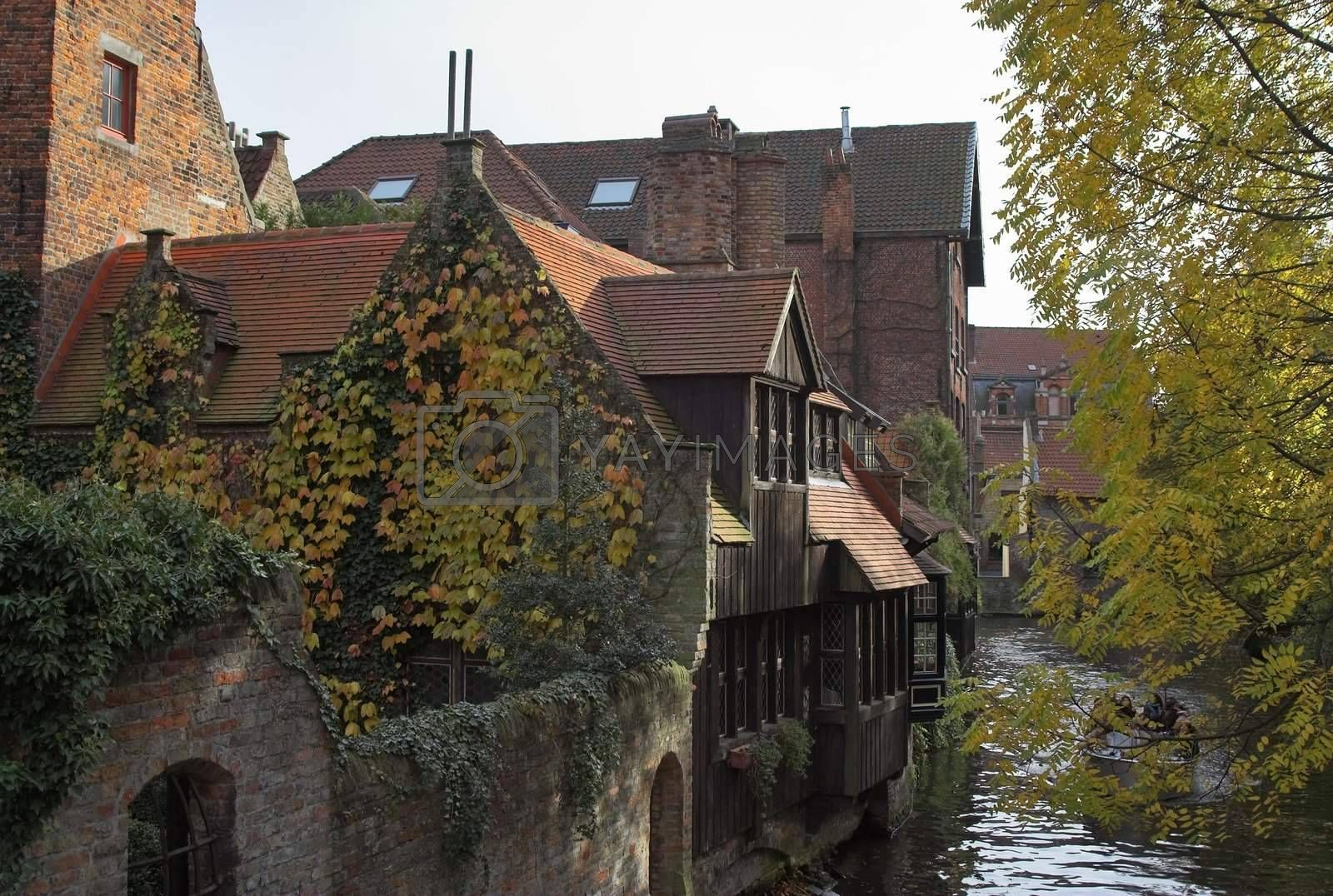 Ancient houses on a channel in Brugge by MikLav