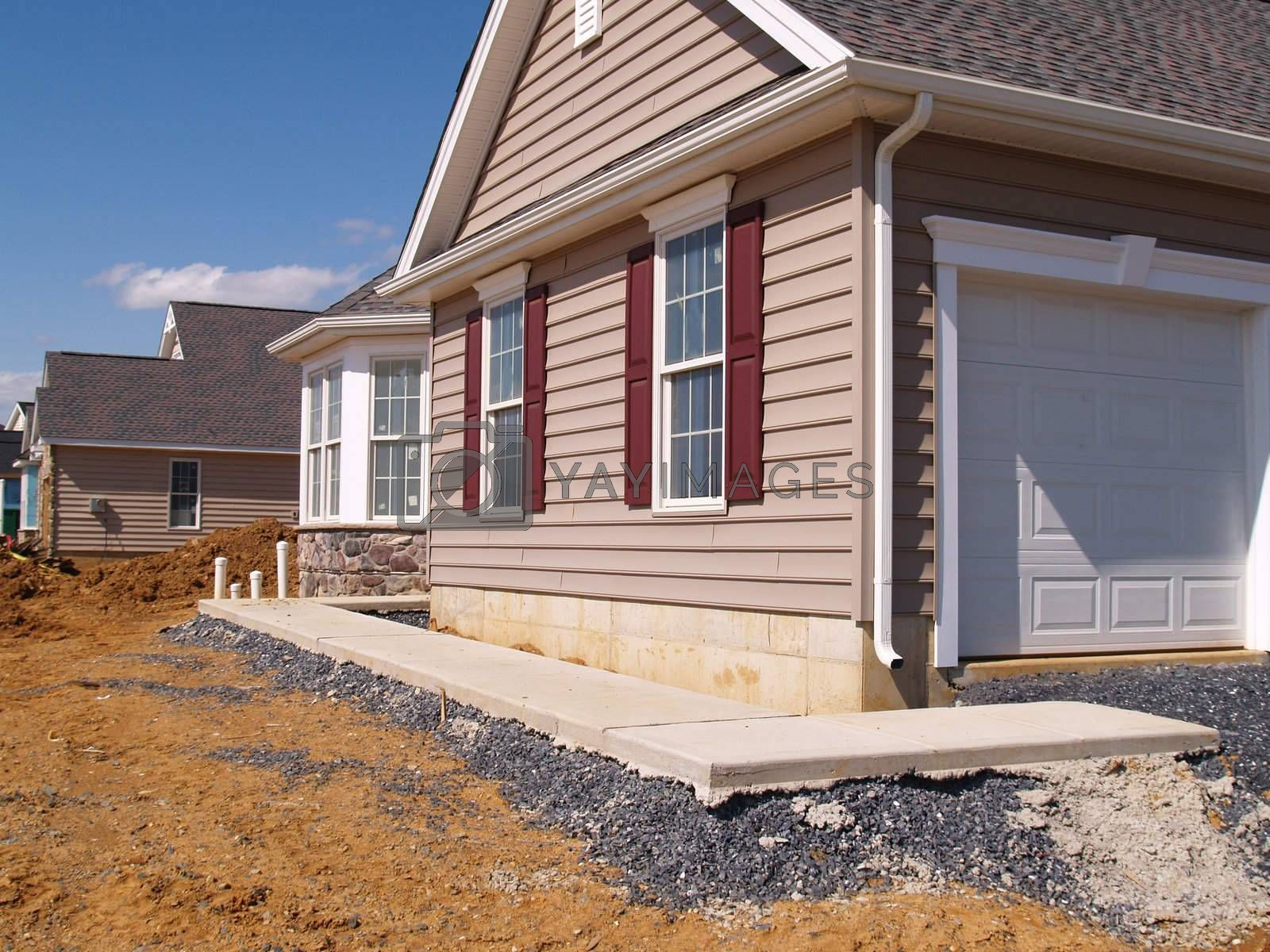 a new sidewalk poured by a new home under construction