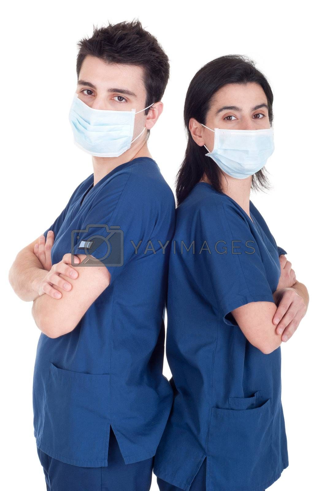back to back portrait of a team of doctors wearing mask and uniform isolated on white background