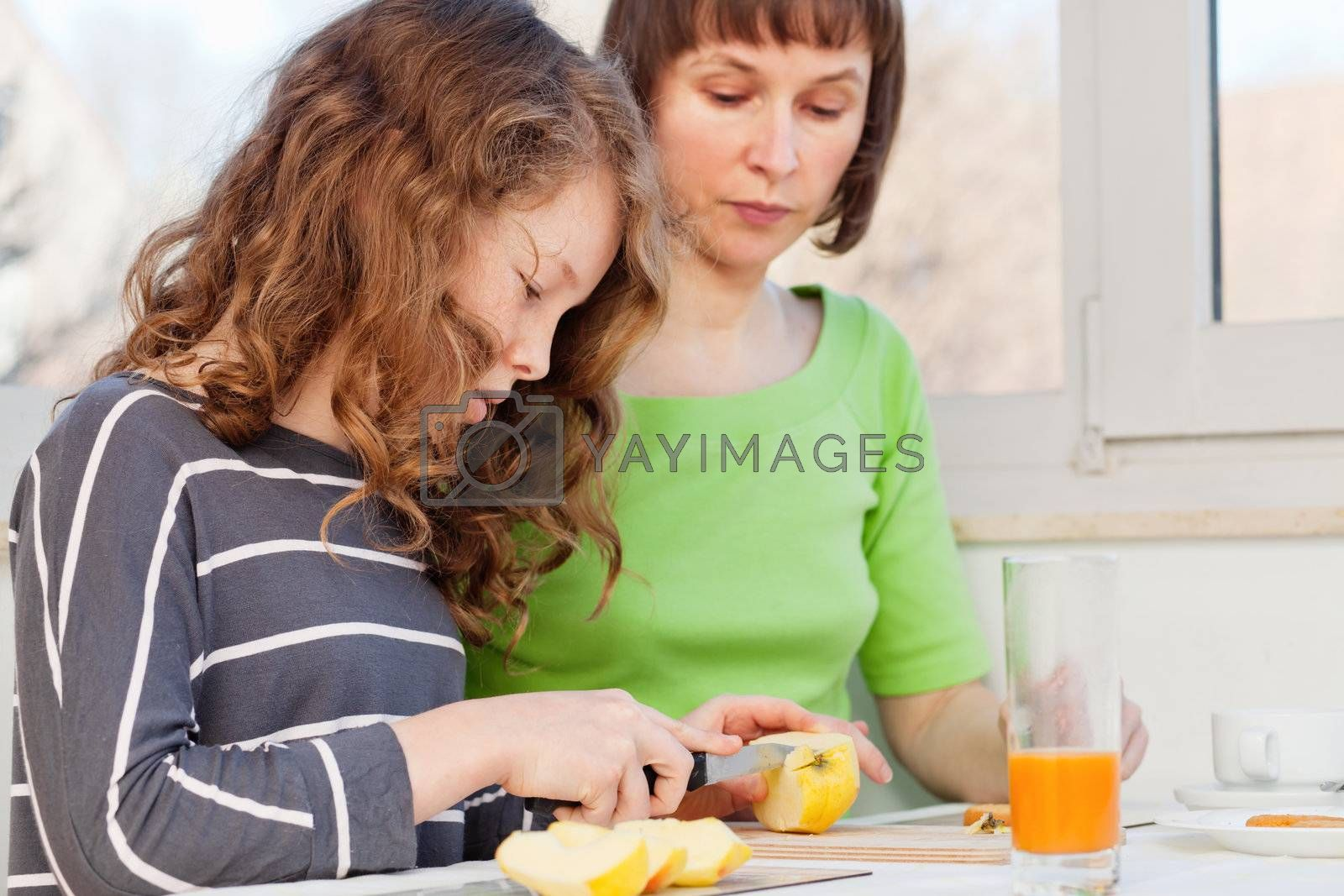 Daughter and her mom having a breakfast together