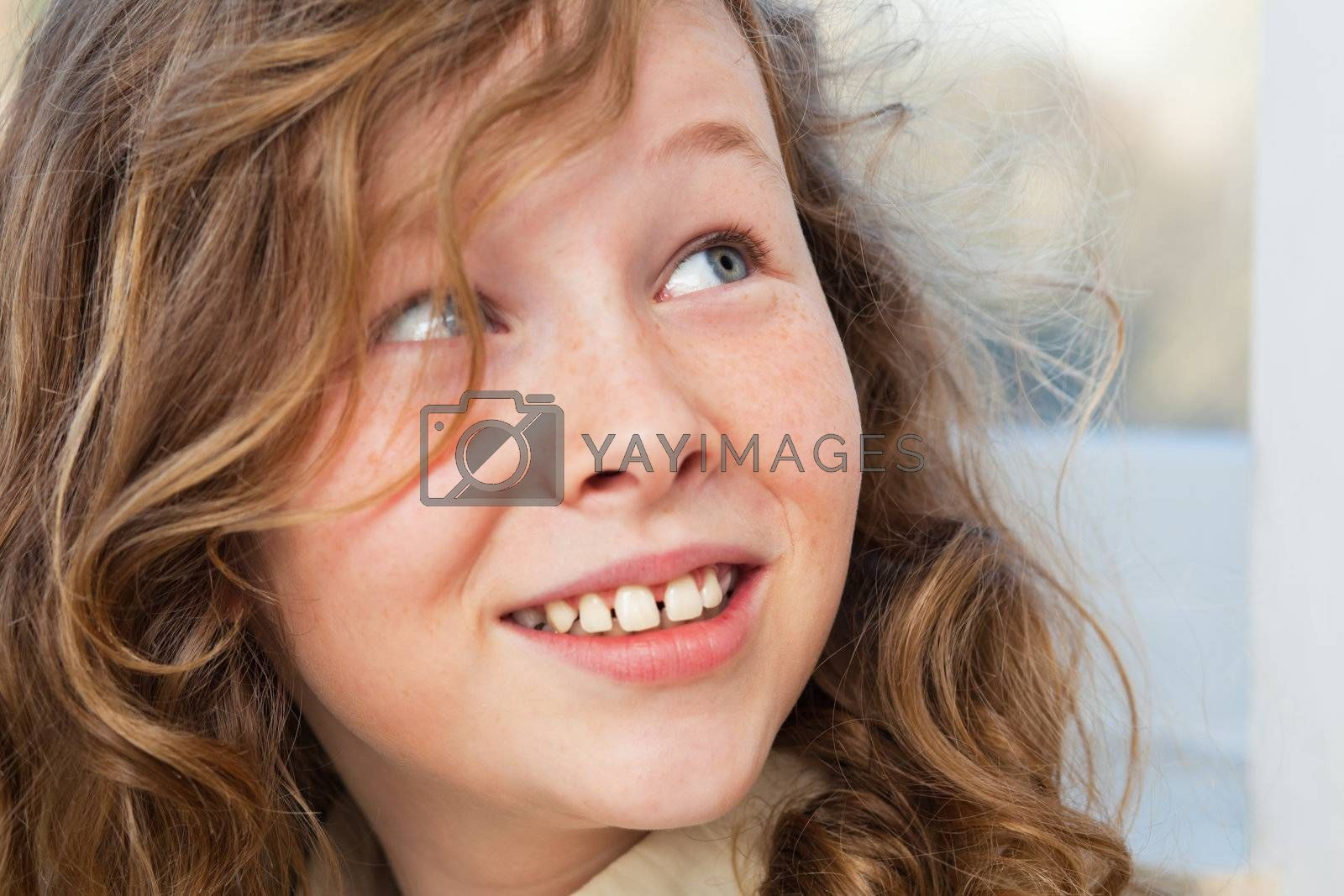 Closeup portrait of a cute teenager girl turning back