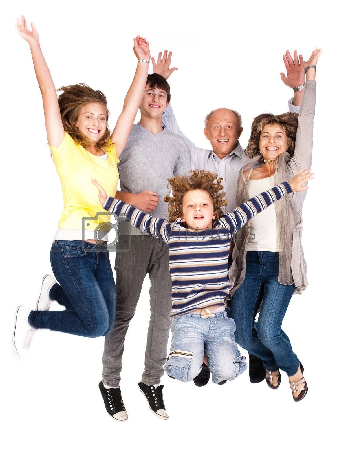 Jumping family having fun, enjoying indoors.