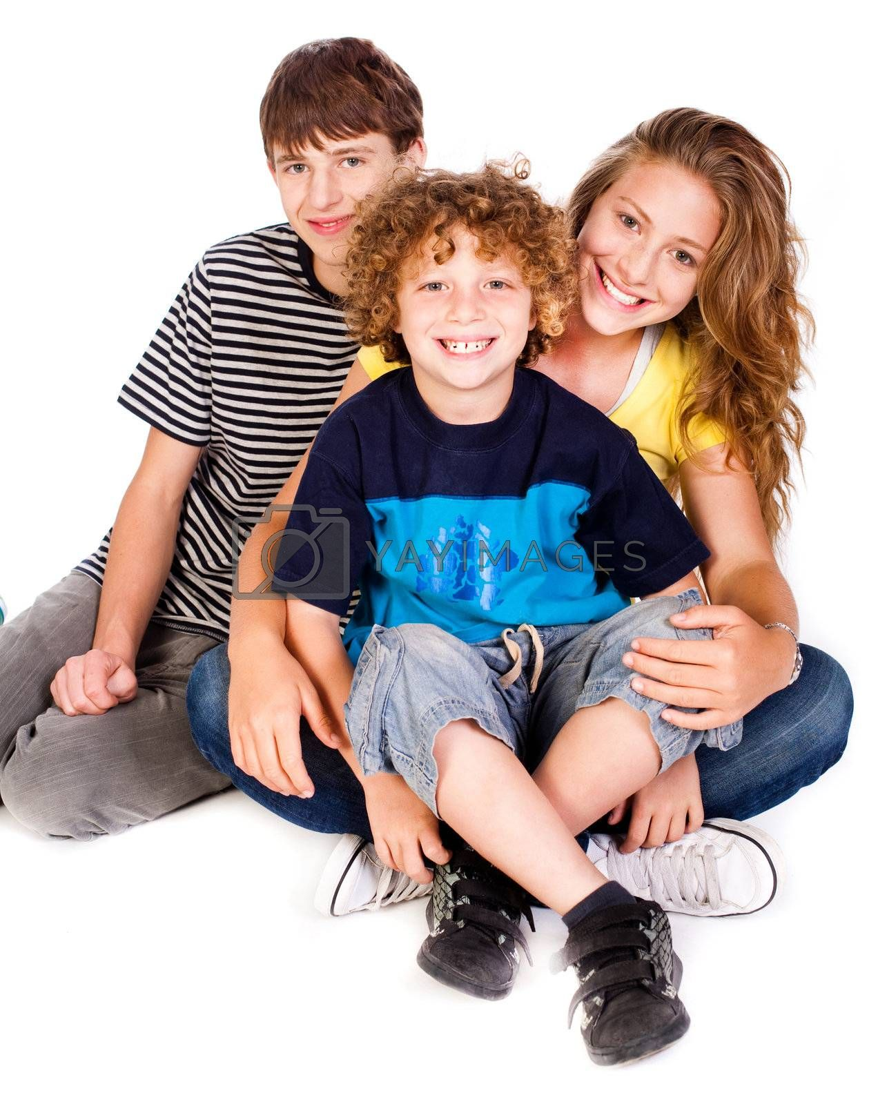 Family having fun on the floor. Posing and smiling at camera.....