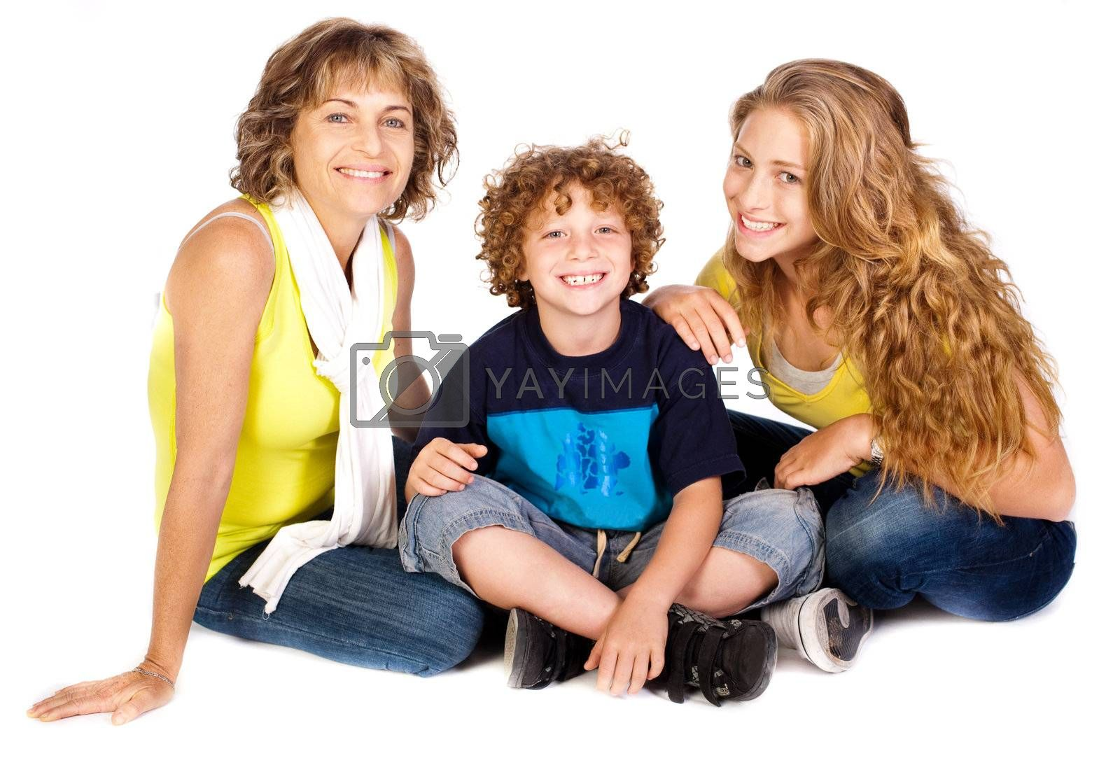 Family having fun on the floor, smiling at camera isolated over the white background.