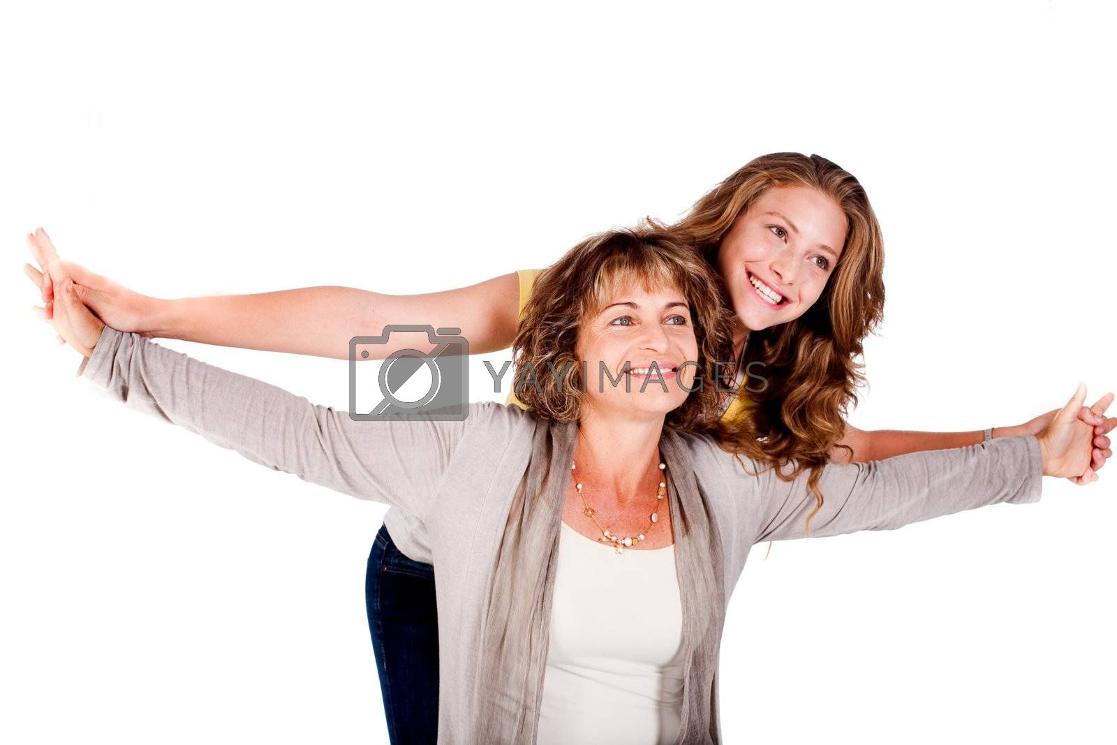Mature mother with her daughter in studio..