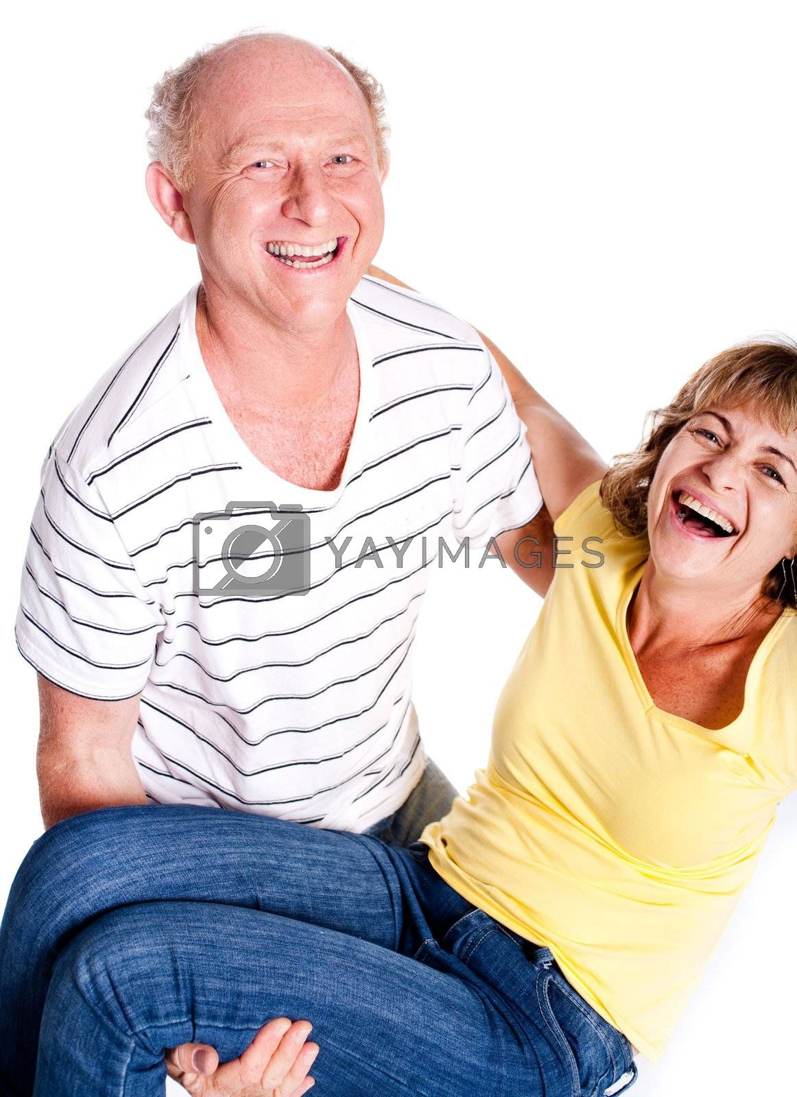A senior man holding his wife in his arms isolated against white background.