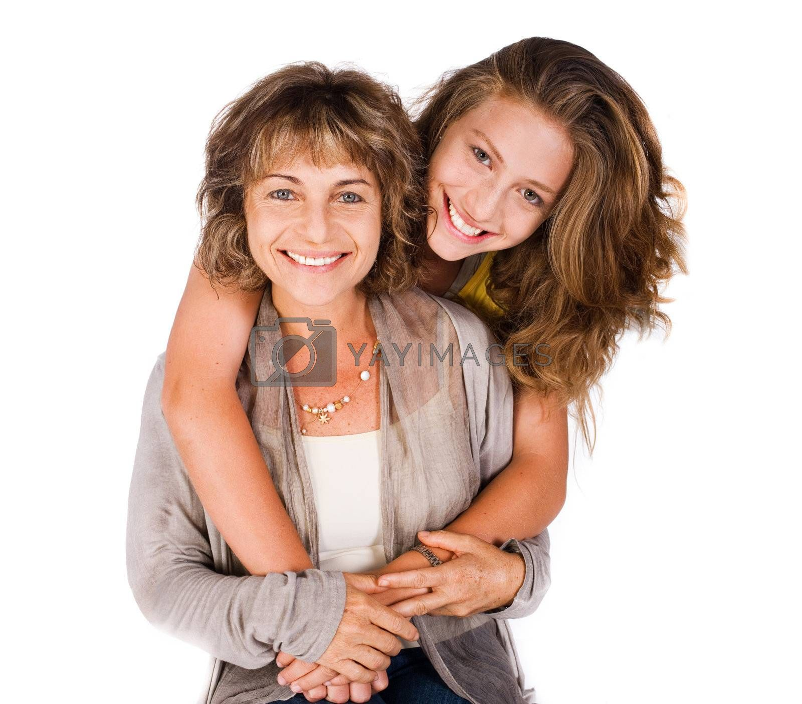 Young pretty daughter hugging her mum from back, indoors.