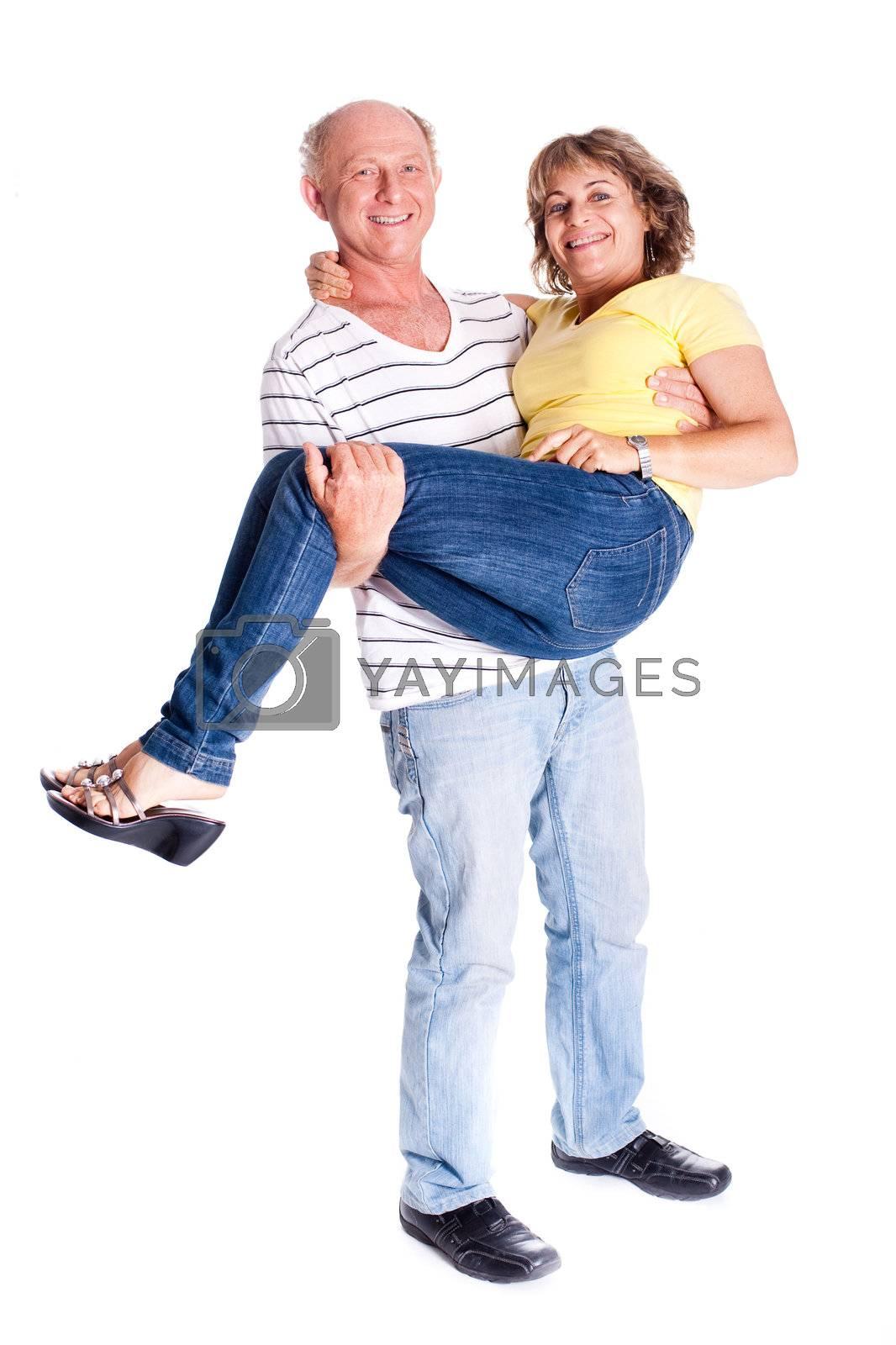 Playful senior couple having fun indoors isolated over white background...