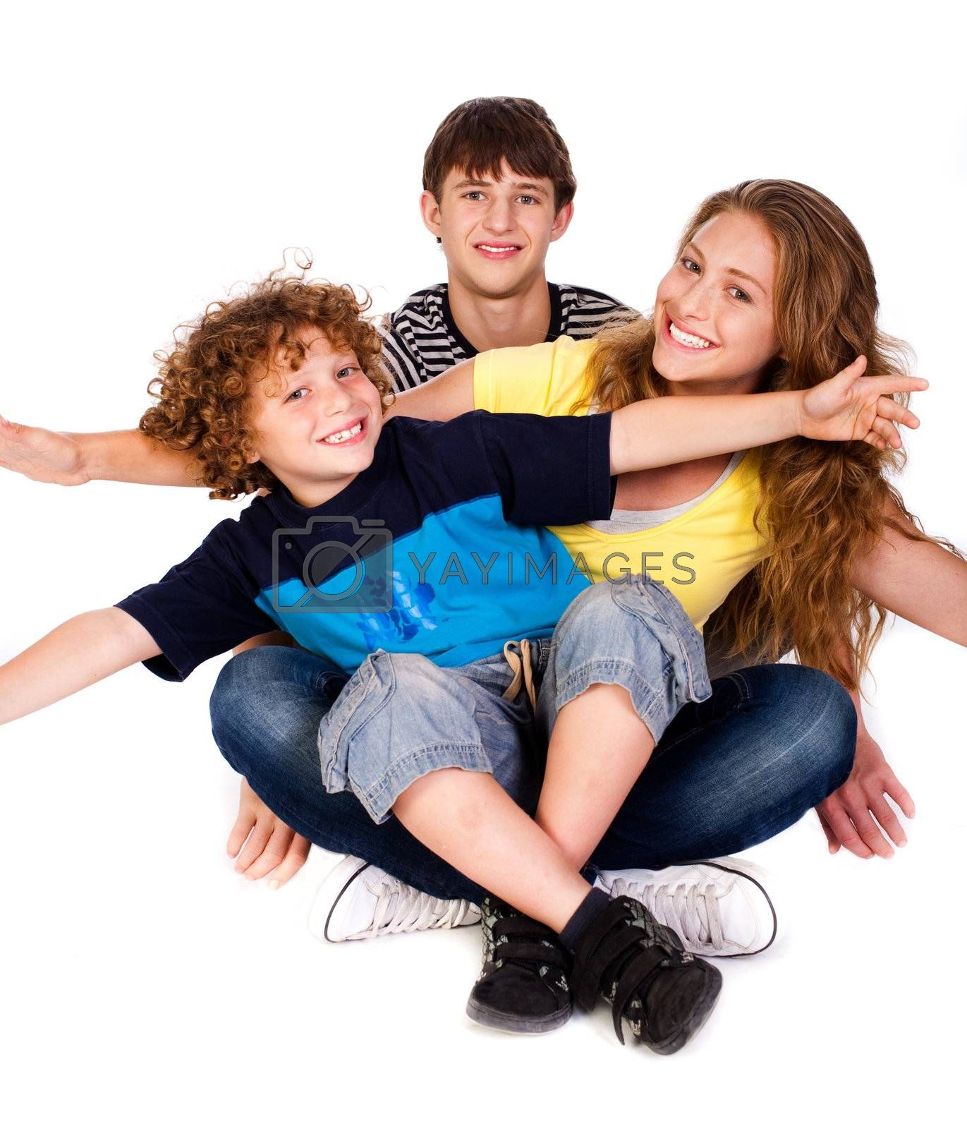 Mother and children sitting on floor isolated over the white background.