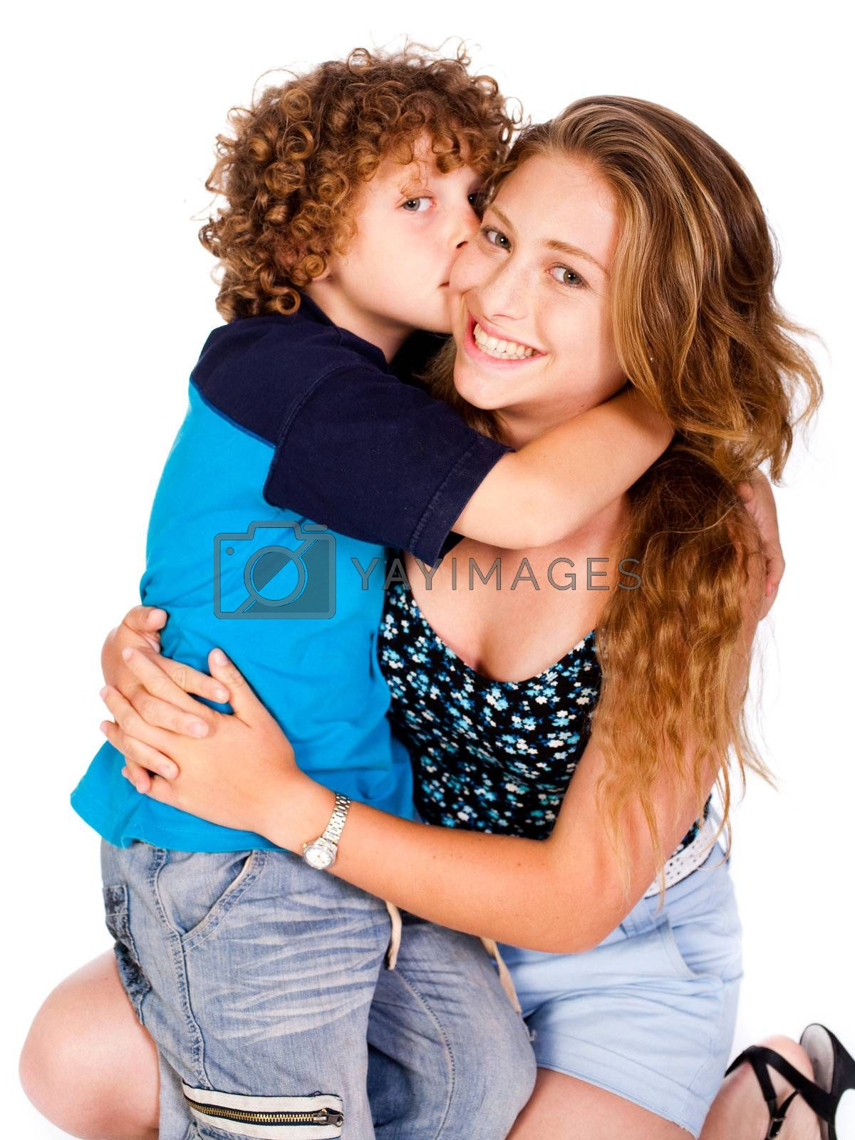 Young kid kissing his mom and looking at camera, isolated on white..