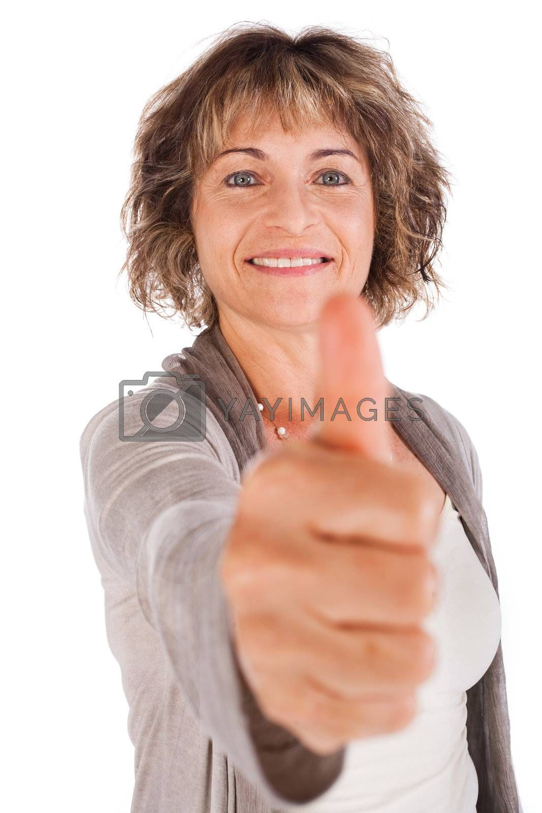 Confident senior woman gesturing thumbs-up isolated over white.